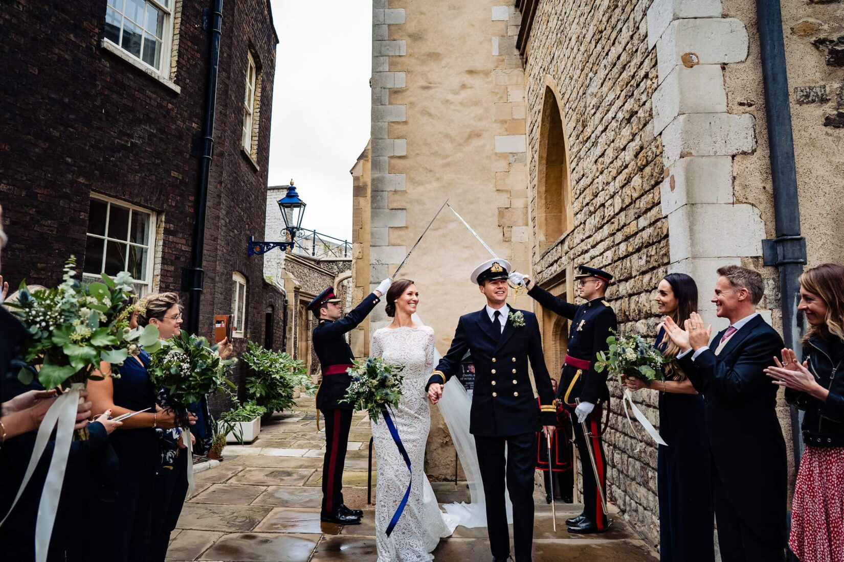 Bride & groom exit church at a Tower of London & Trinity House Royal Navy Military Wedding