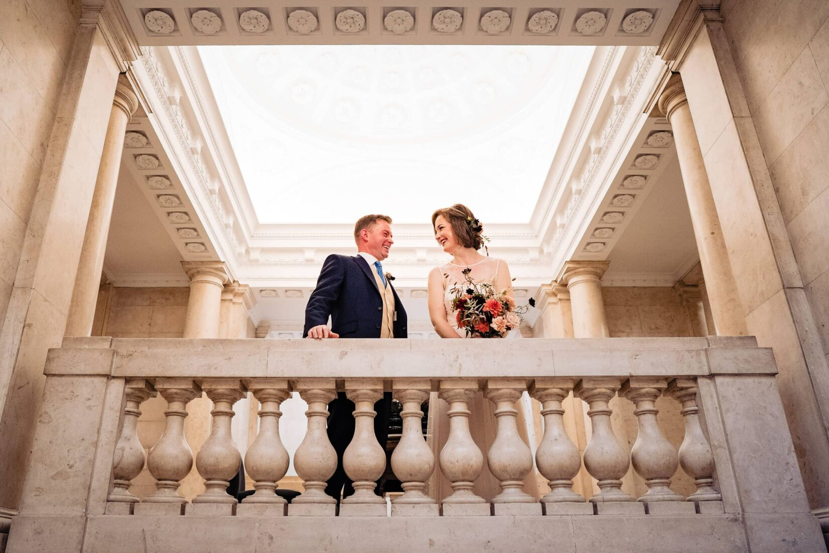 Bride and groom smile at each other at their Old Marylebone Town Hall Wedding ceremony