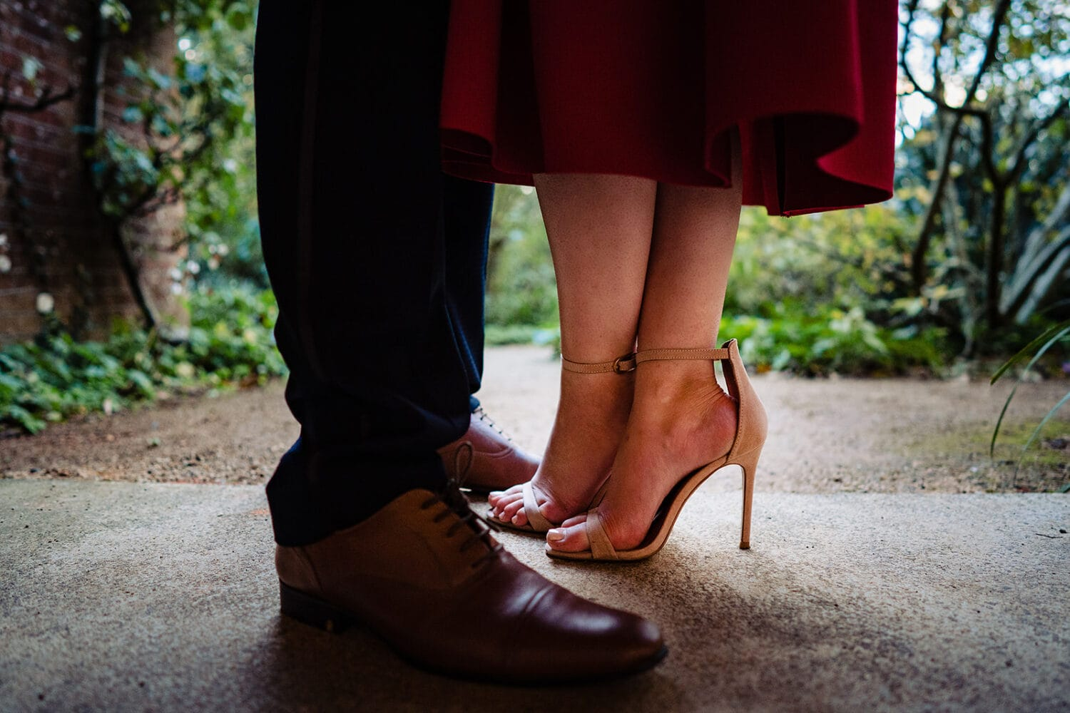 Engaged couple's feet standing close