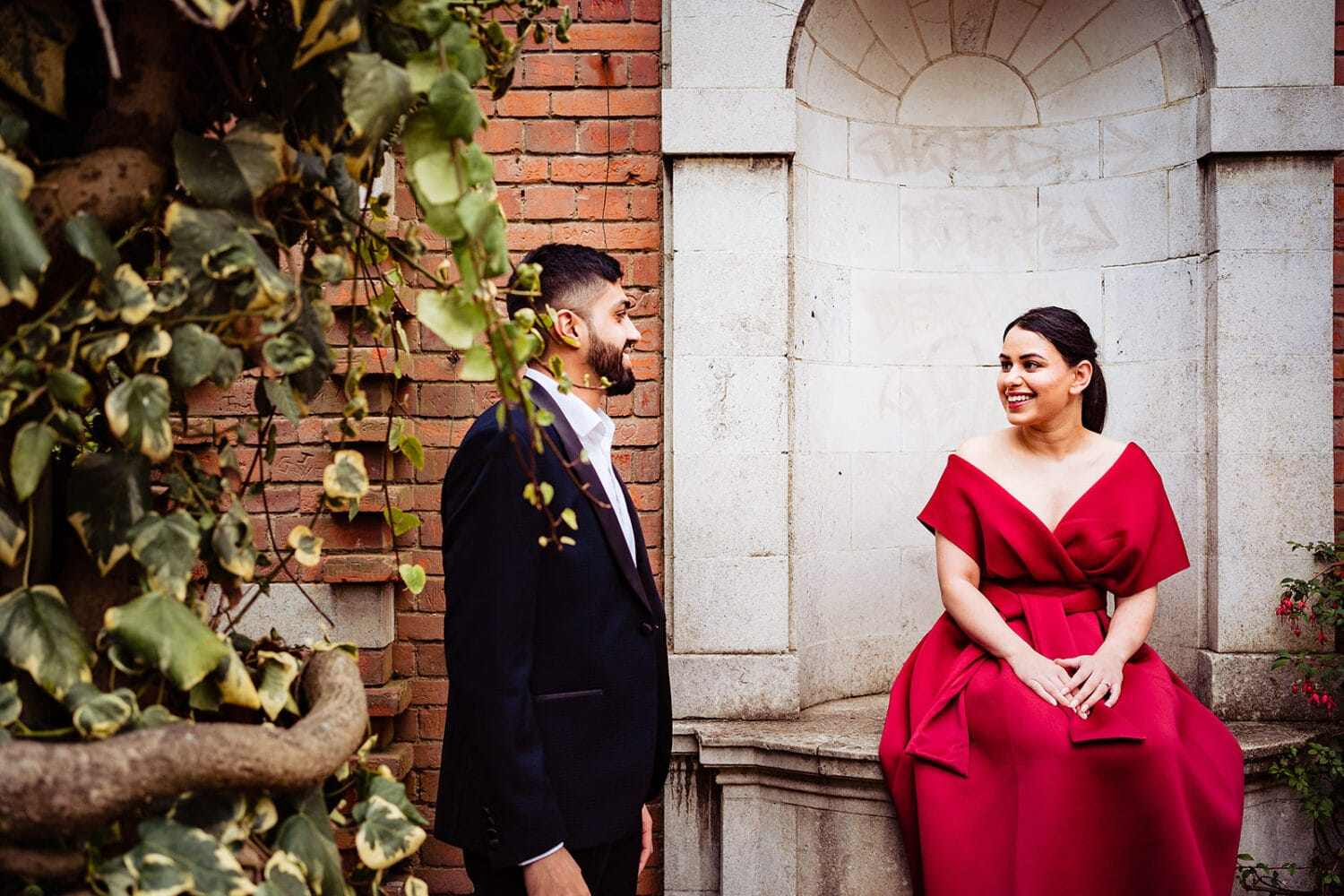 Asian couple chat at the Hampstead Pergola in London