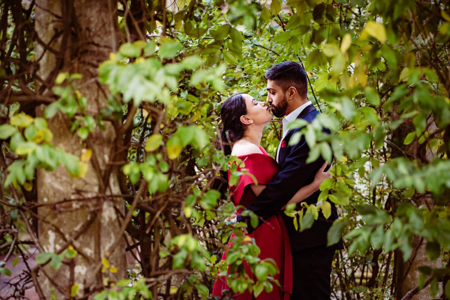 Asian couple kiss at their Hampstead Pergola engagement shoot