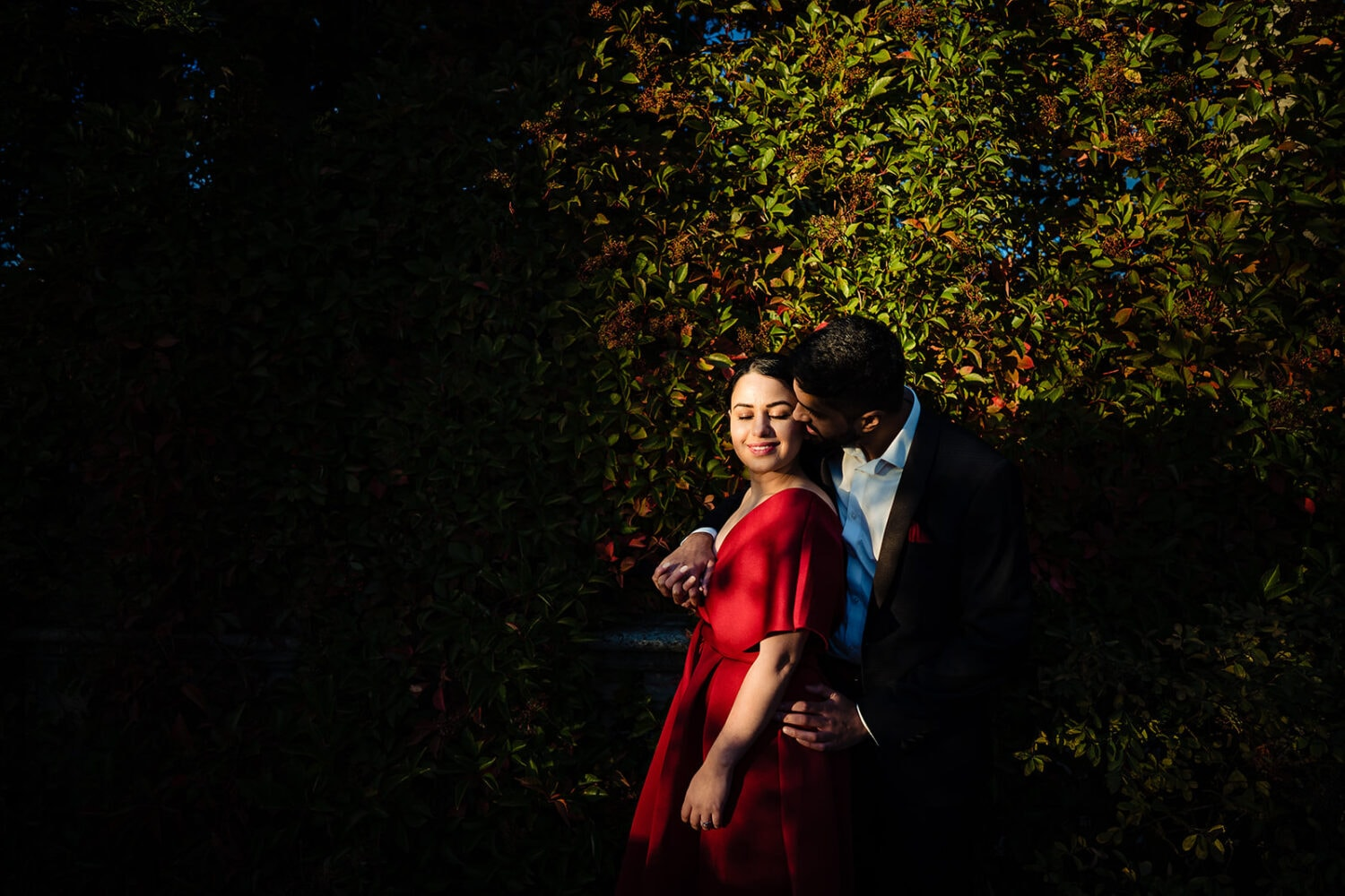 Asian Bride and groom hug at a golden hour engagement shoot
