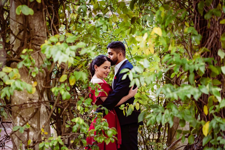 Asian couple kiss at their Hampstead Pergola Pre-wedding shoot