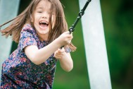 Little girl having fun using the zip line in Kemsing and Otford, in Sevenoaks, Kent
