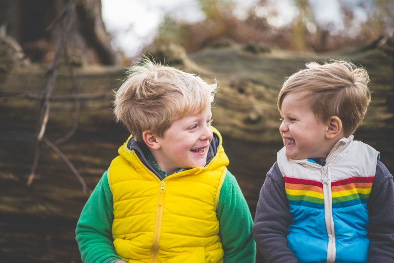 Two brother laughing at each other at Knole Park Family and children photo shoot