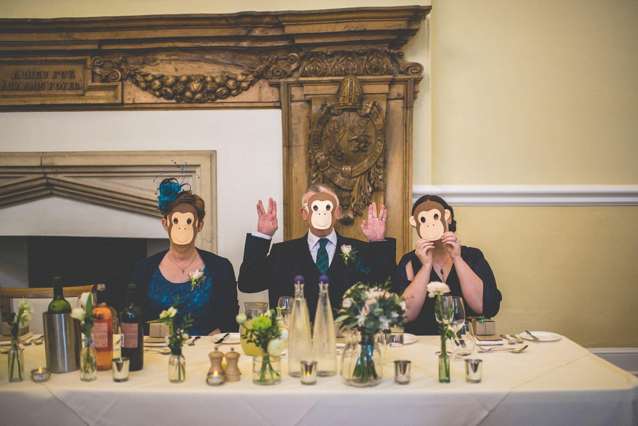 Farnham Castle Wedding guests with monkey masks on