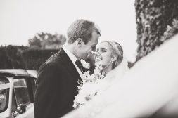 Bride and Groom smiling happily in the rain at their St Audries Park wedding