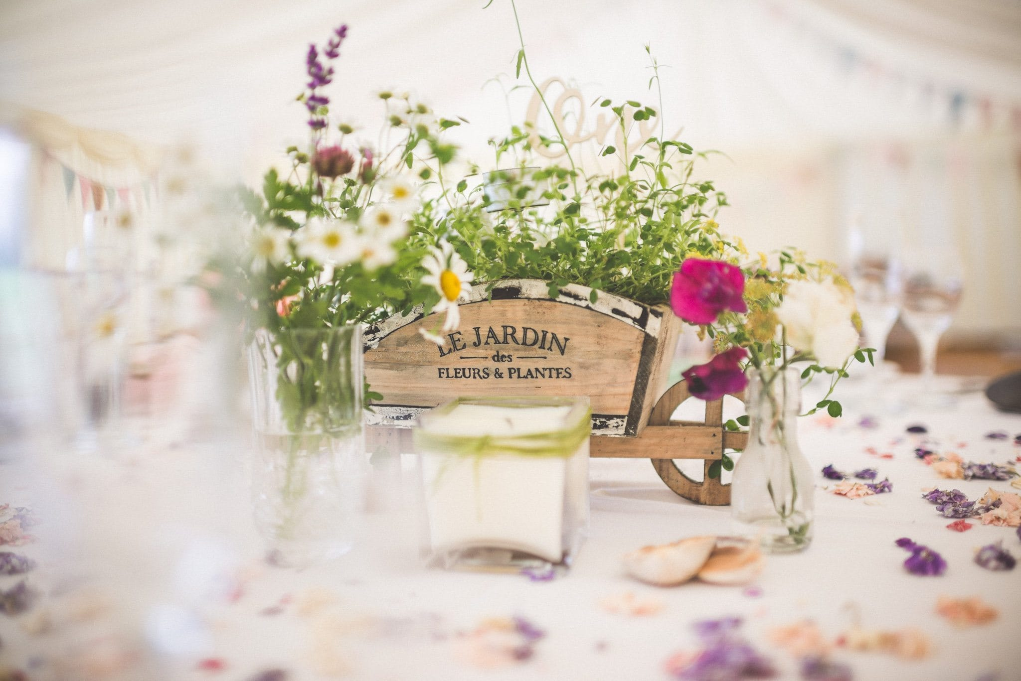 Rustic floral centrepieces in the marquee