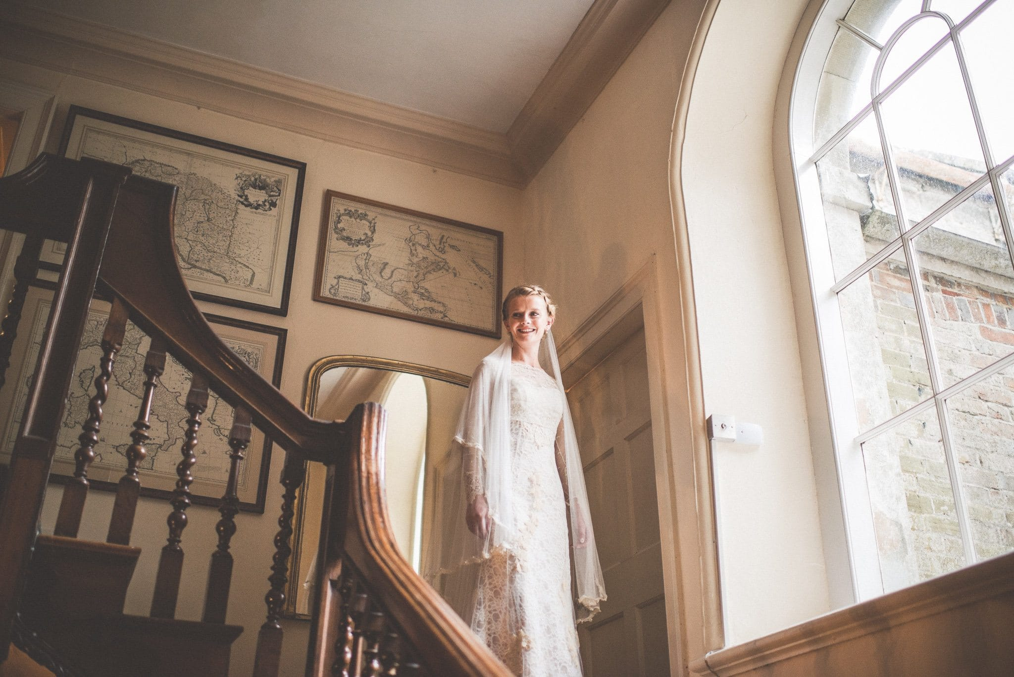 Bride descends the staircase at Smedmore House