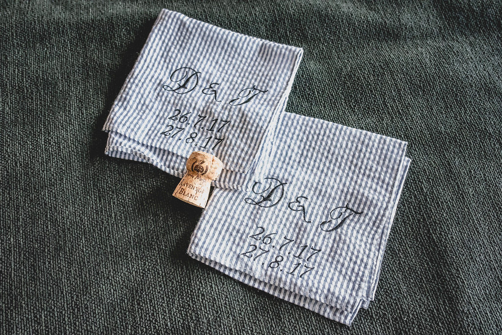 Drew and Tom's monogrammed pocket squares showing their elopement date