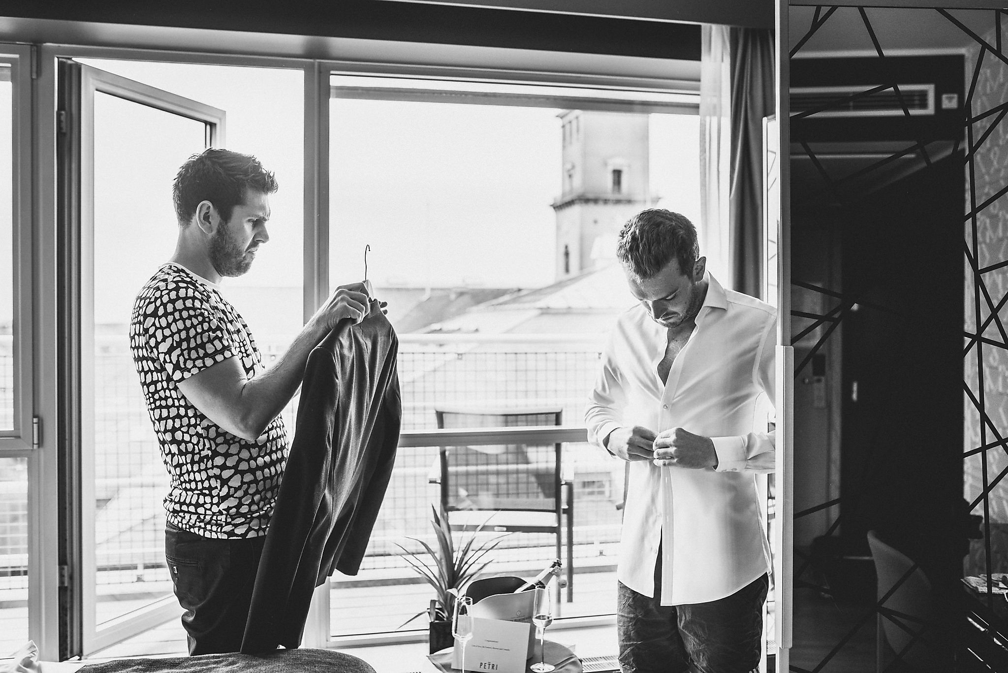 A black and white shot of Drew and Tom getting ready for their elopement in Copenhagen