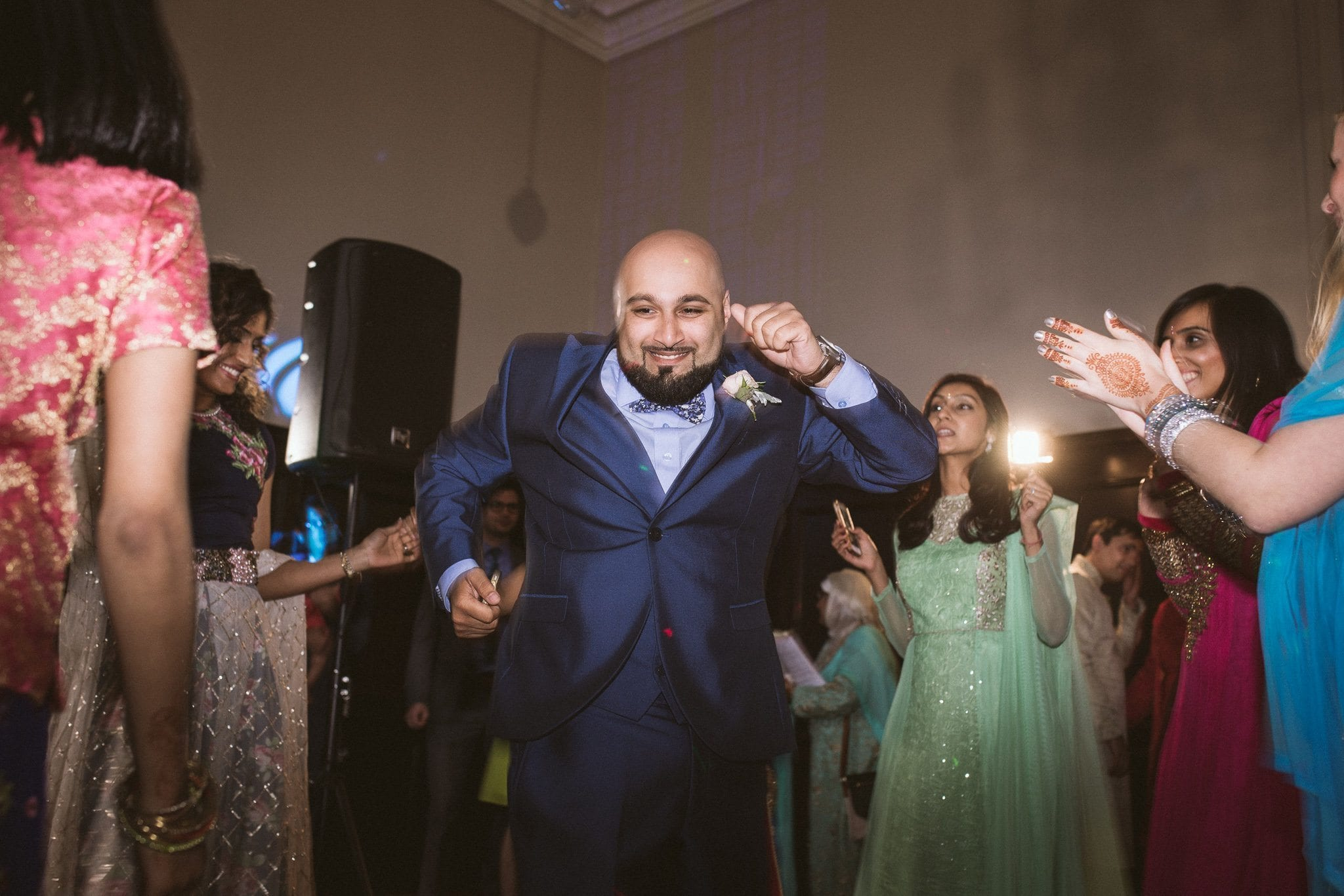 A male guest shows off some serious moves on the dancefloor at Sorayya and Usman's wedding party