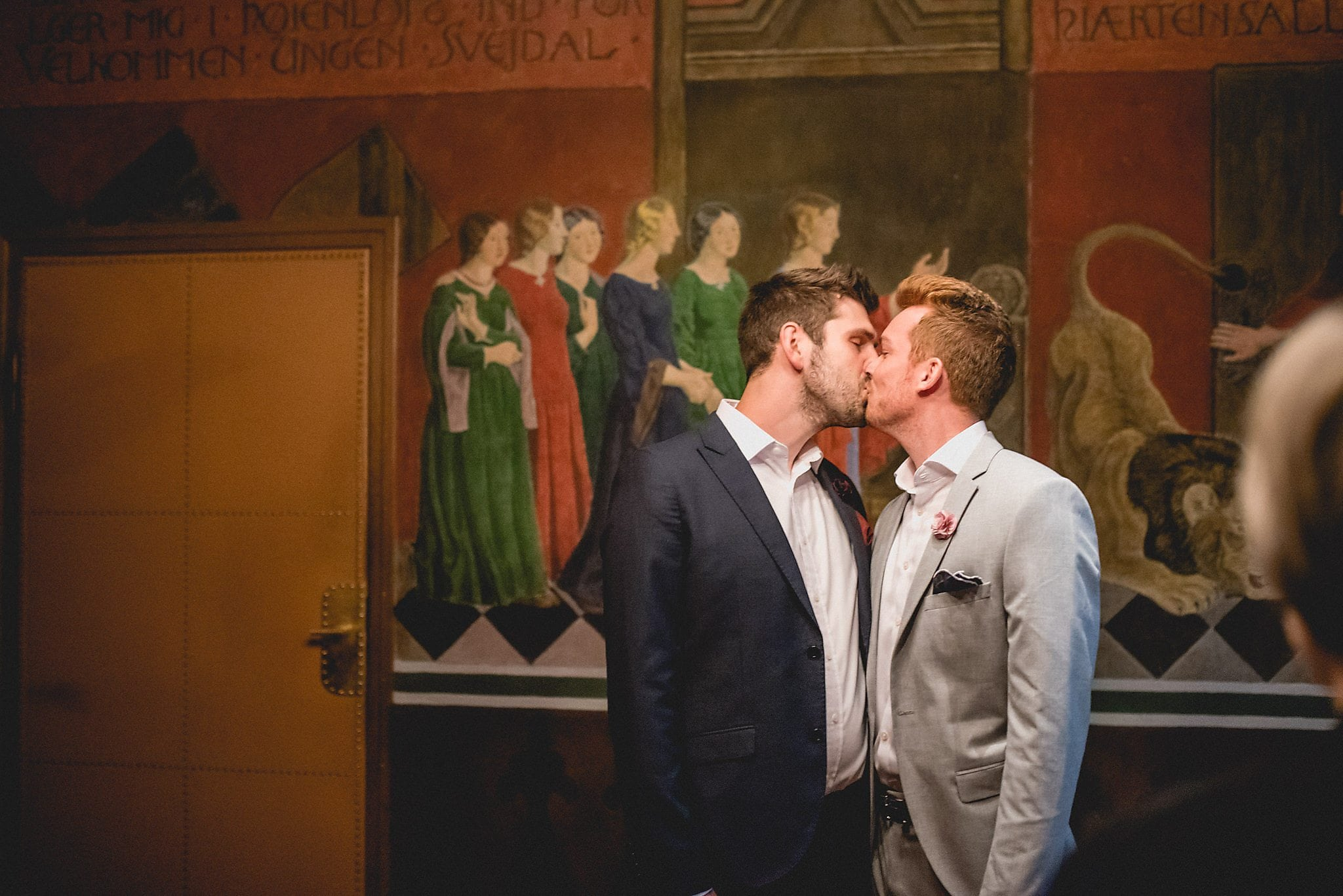 The newlyweds share a kiss in the ceremony room of the Copenhagen Radhus
