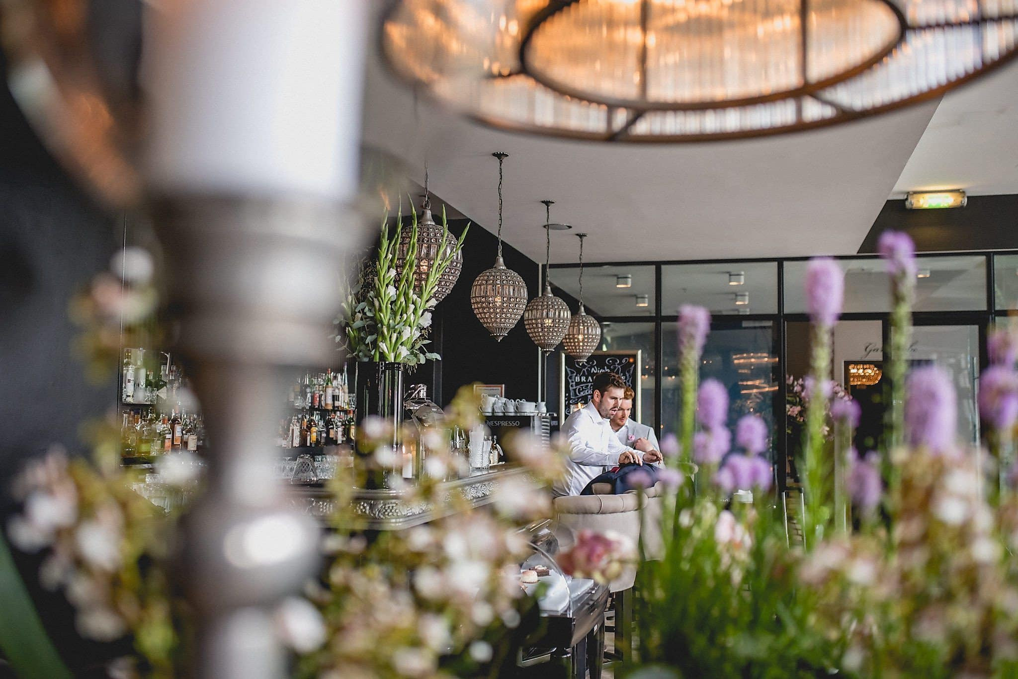 A view of the couple across Nimb restaurant in Copenhagen, taking in some of the pewter candlesticks and floral arrangements