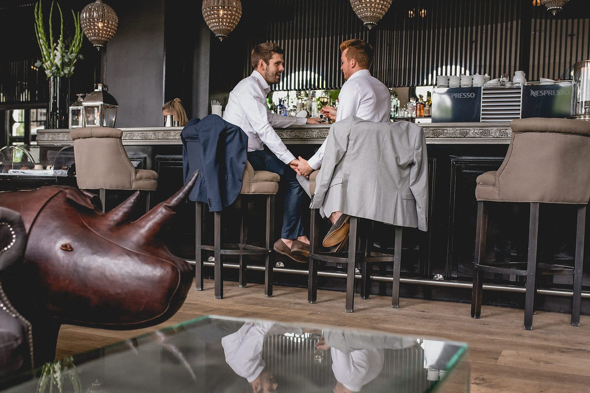 Two grooms celebrate at a stylish Copenhagen Restaurant