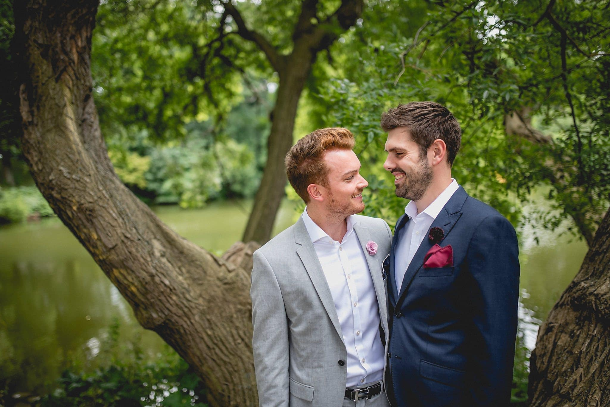 Two grooms smile together during their Copenhagen elopement