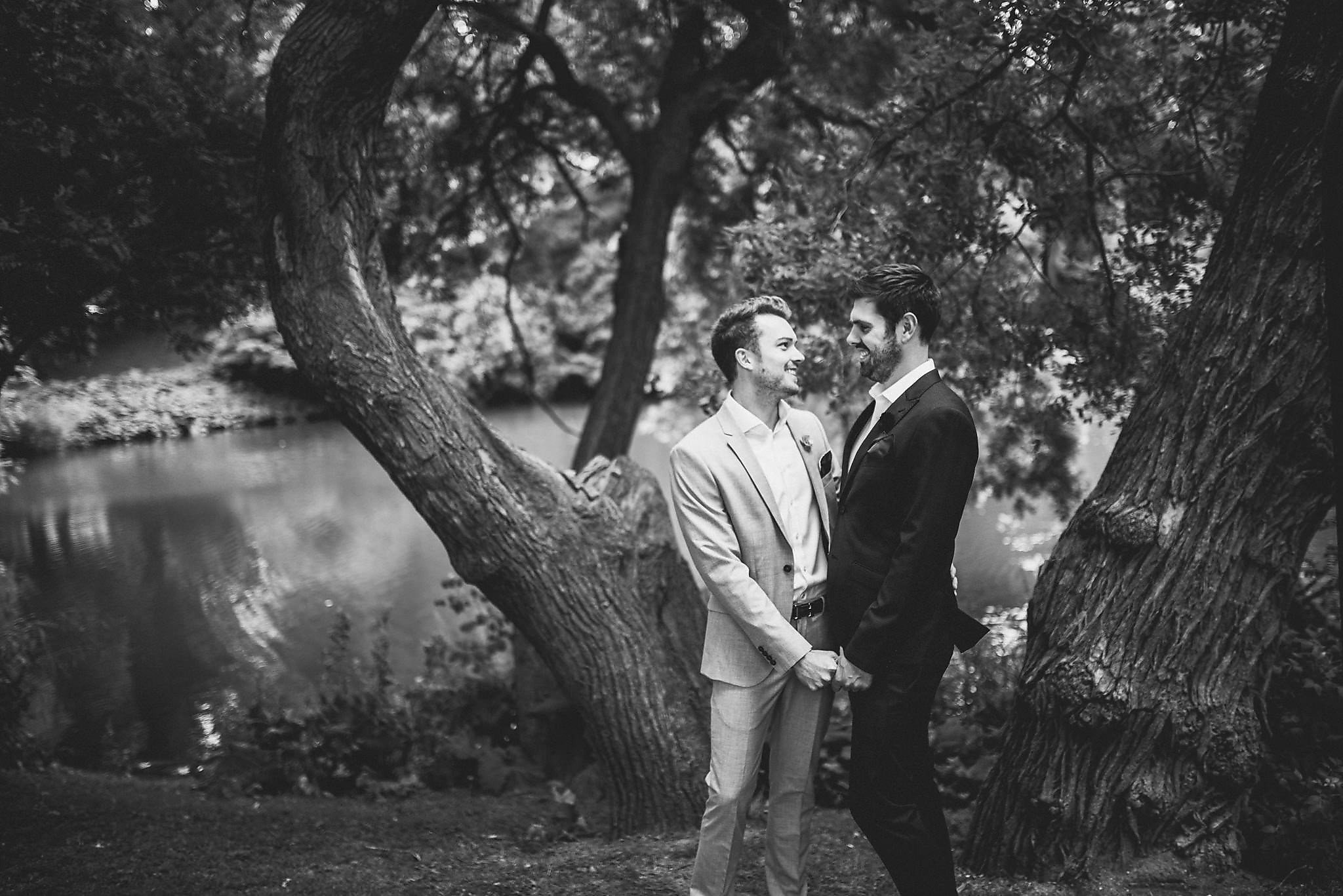 A black and white shot of Tom and Drew in the park during their couple's shoot before their ceremony in Copenhagen
