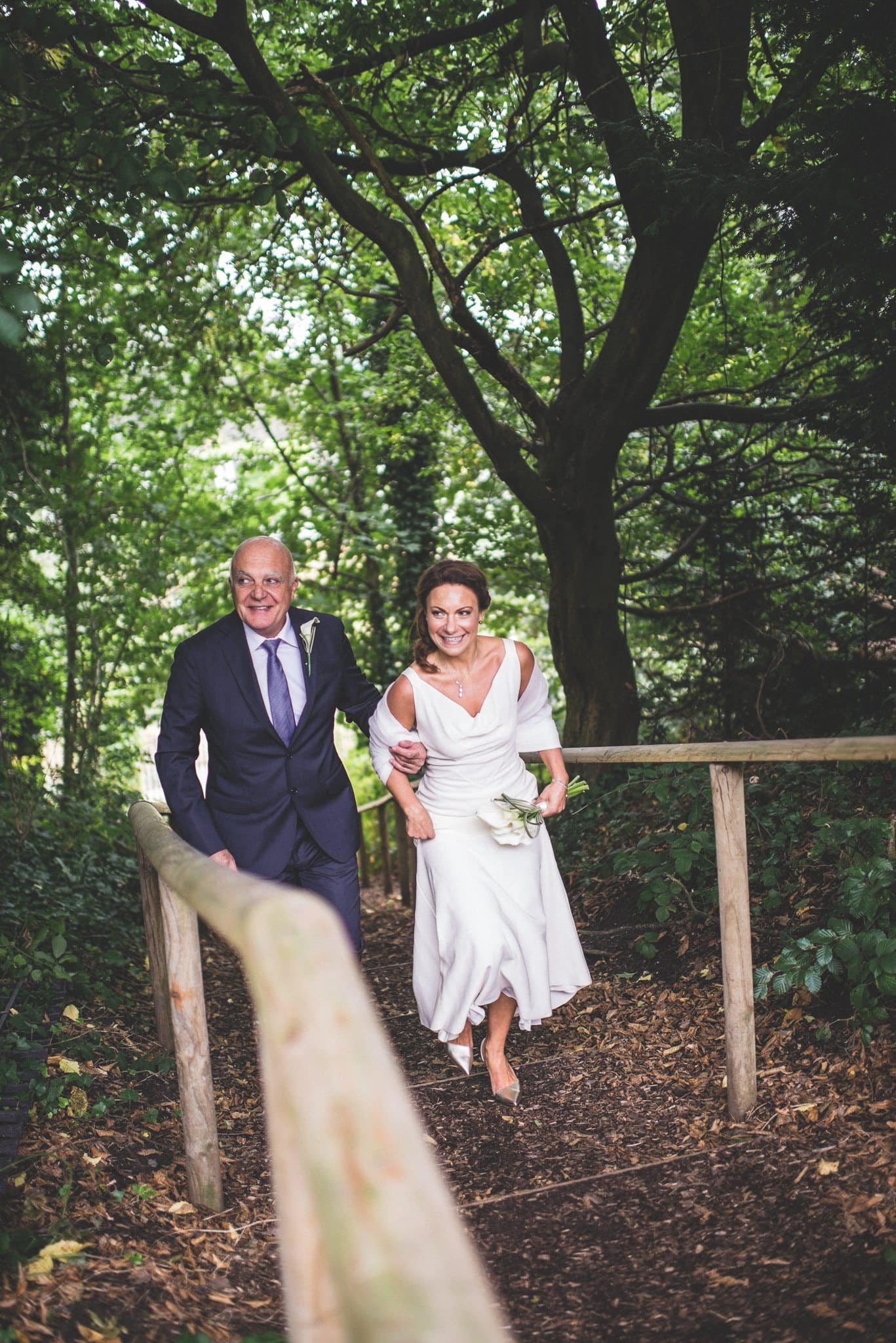Ilaria and her father climb the stairs to the ceremony venue on Hampstead Heath