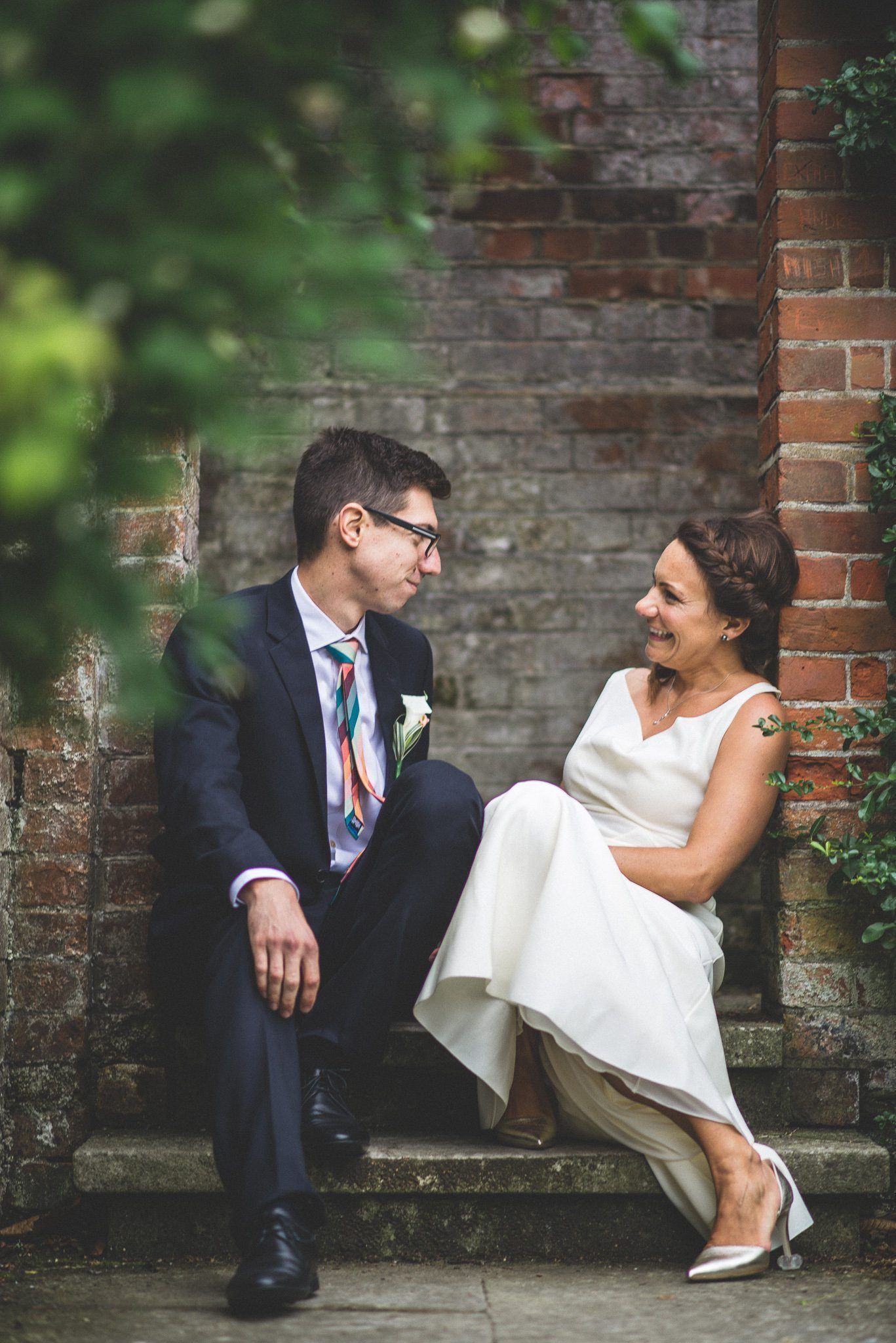 Ilaria laughs as her new husband gazes fondly at her. The couple sit in an archway at the Hampstead Heath pergola