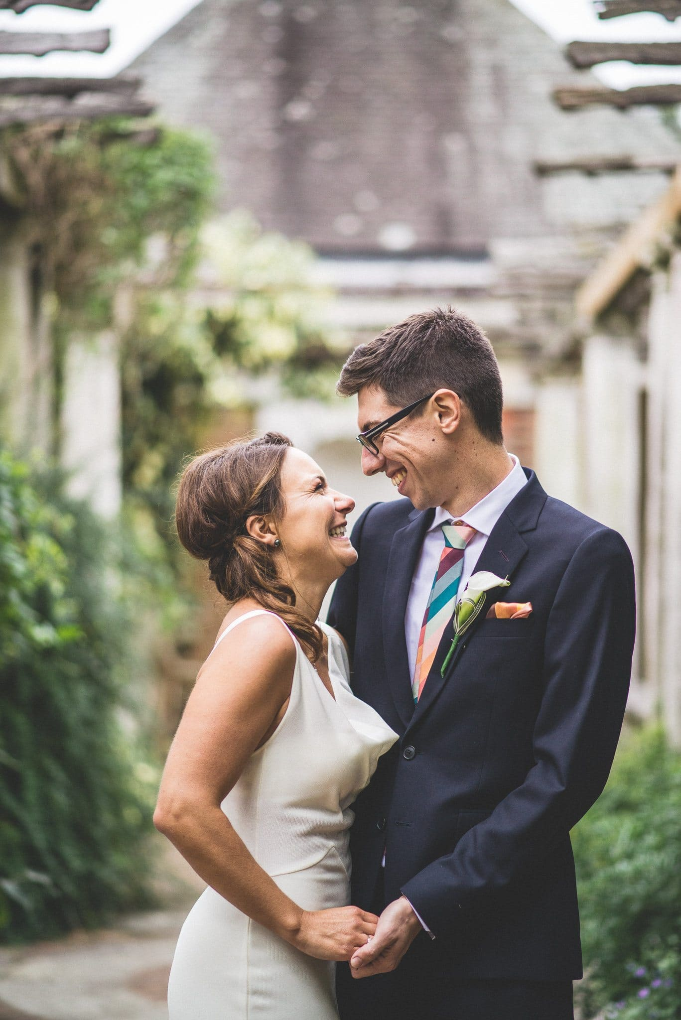 Ilaria and Marco grin joyfully at each other during their couple's shoot after the wedding ceremony