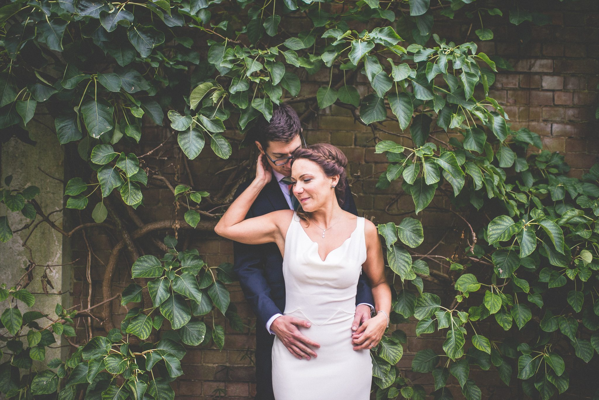 Bride and groom hugging at their Hampstead Pergola wedding