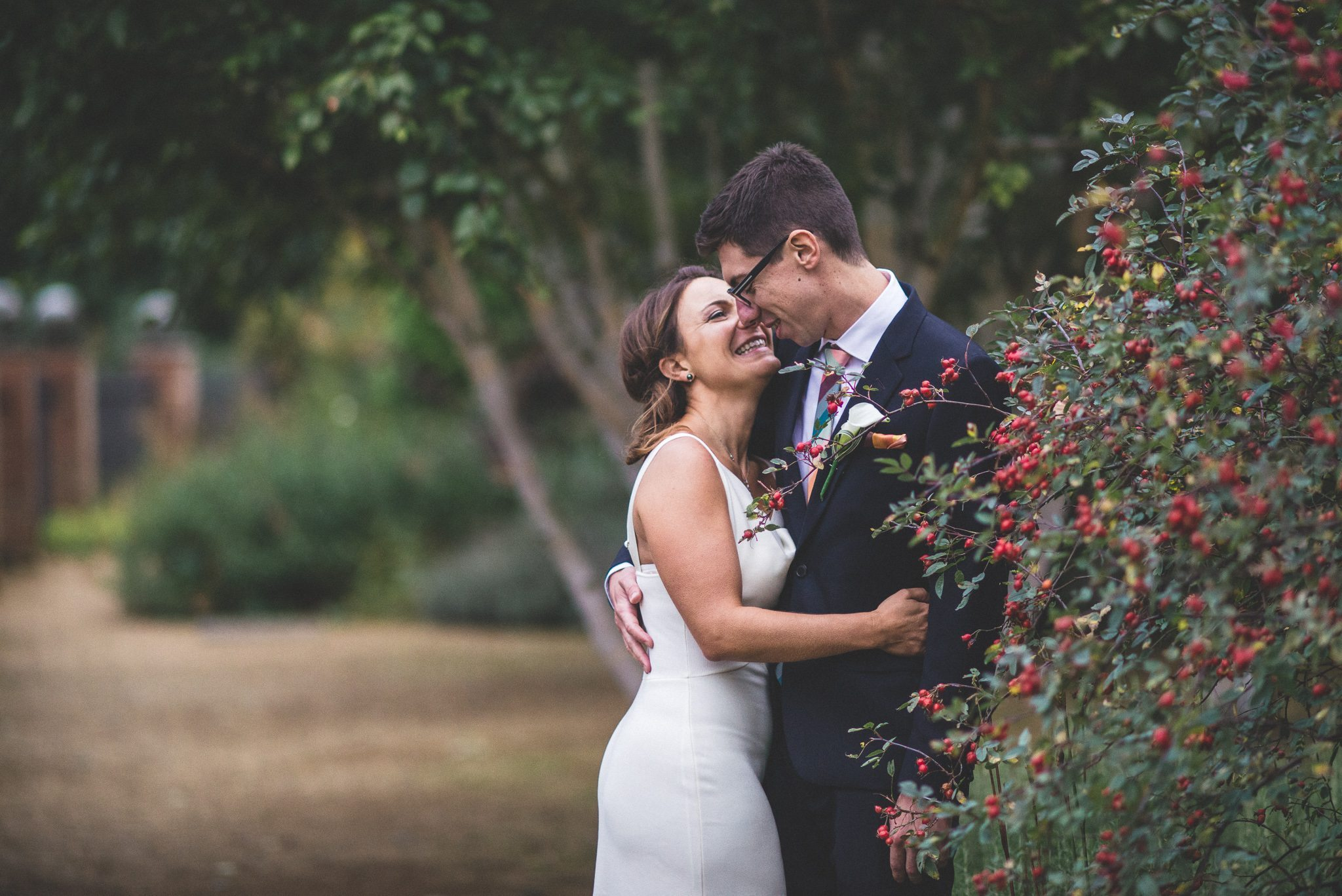 Bride and groom laughing at their Hampstead Pergola Wedding