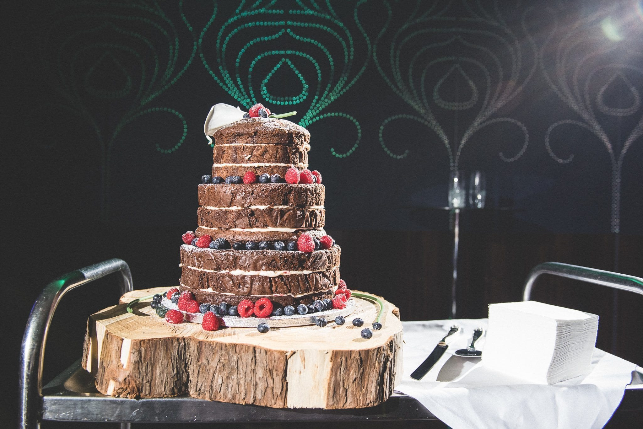 The wedding cake - naked chocolate cake decorated with berries - and ready to be cut
