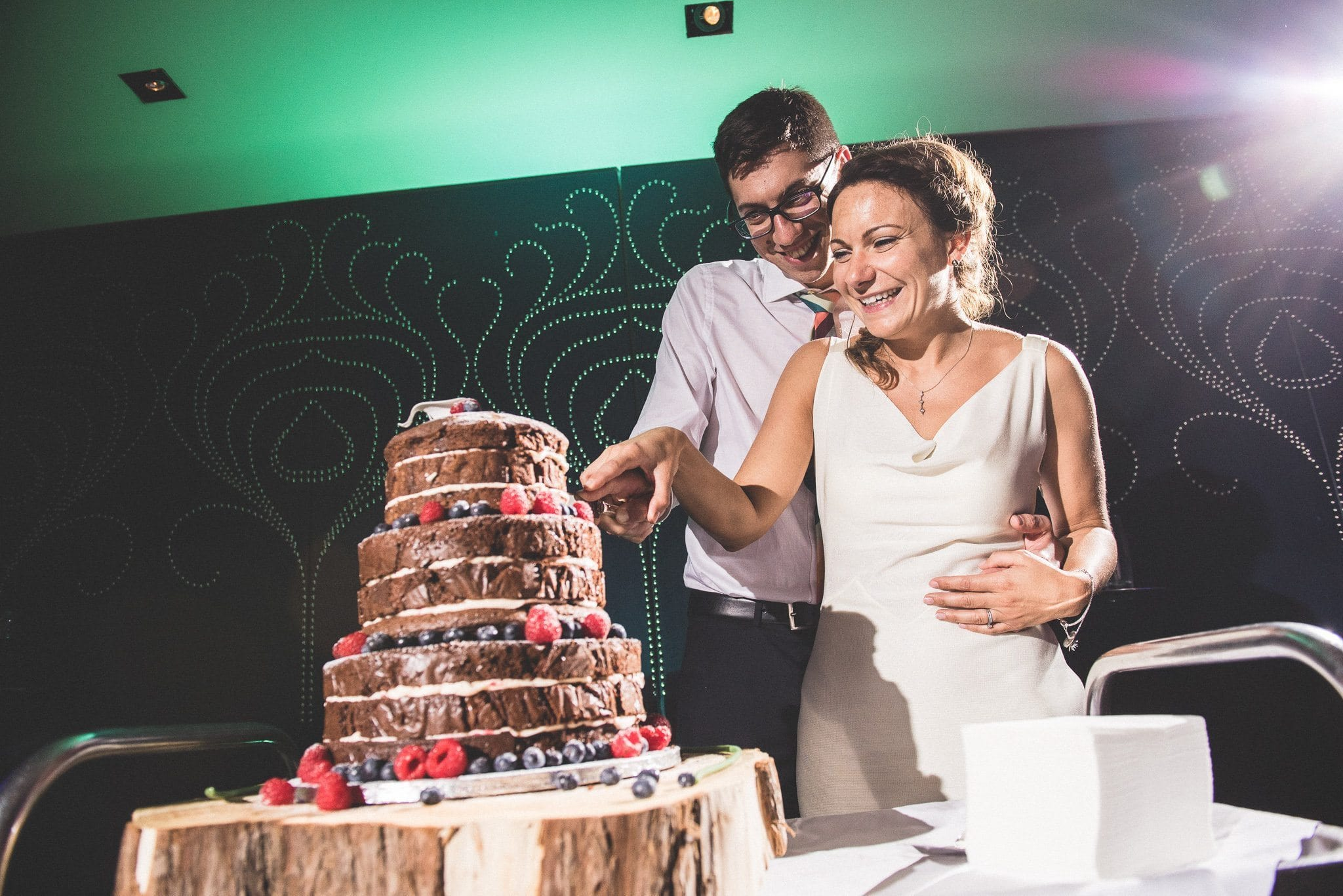 The couple cut their chocolate wedding cake