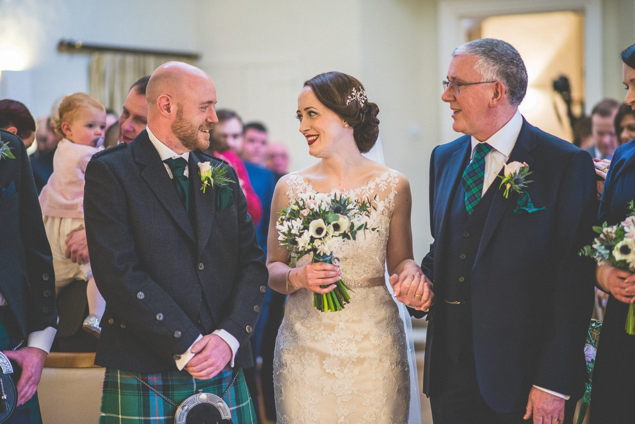 The father of the bride gives his daughter away to be married