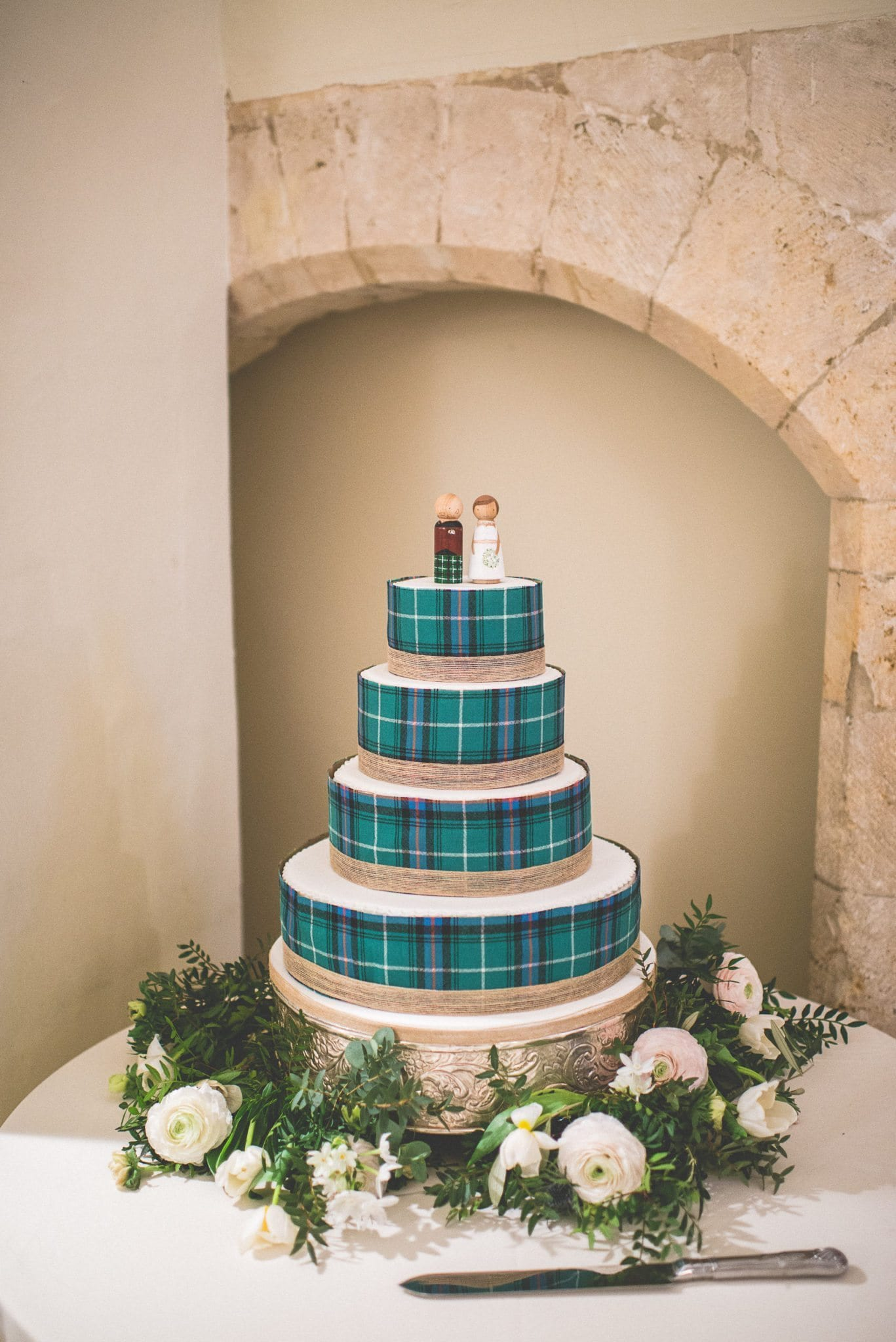 The couple's 4-tiered tartan wedding cake, made by the bride.