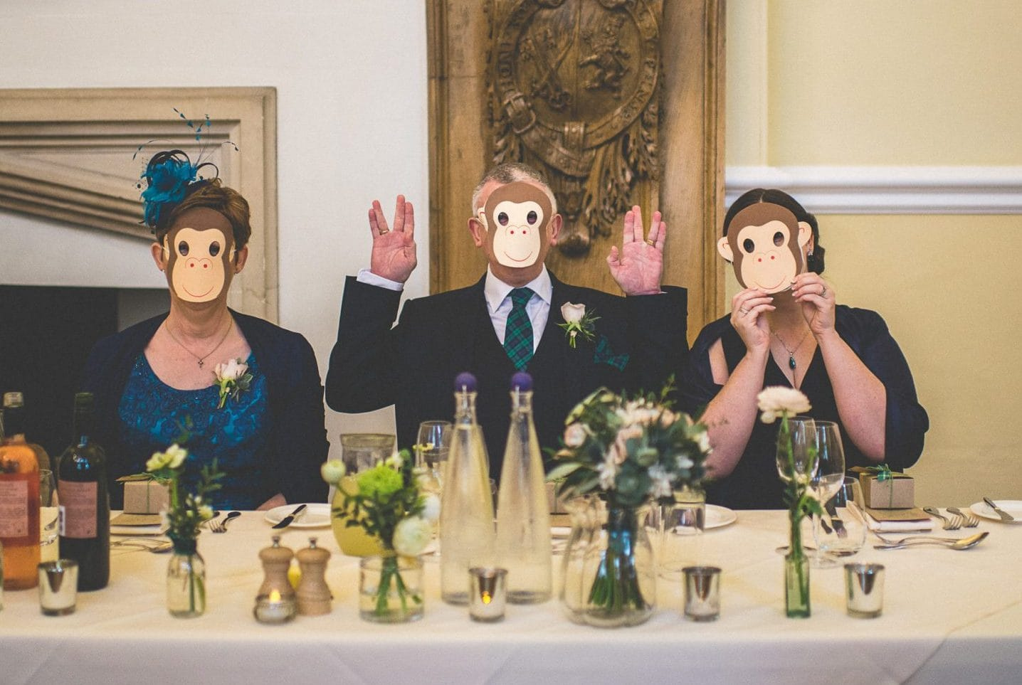 Break the mould by wearing monkey masks like these wedding guests