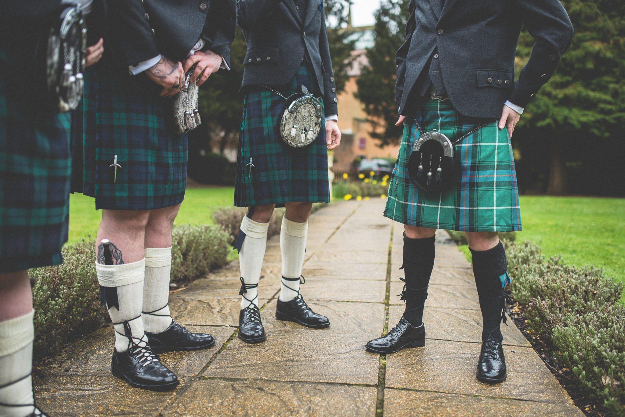 Scottish groom and groomsmen preparing for a scifi unique Farnham Castle Wedding
