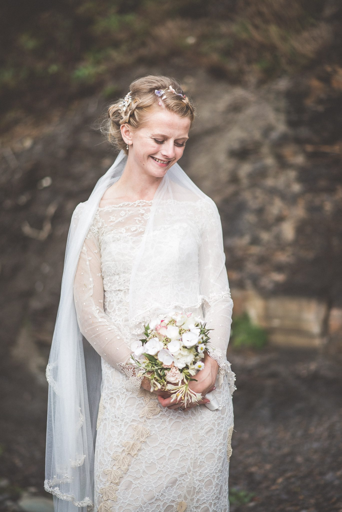 Smedmore House bride smiling happily in her handmade dress in Kimmeridge Bay