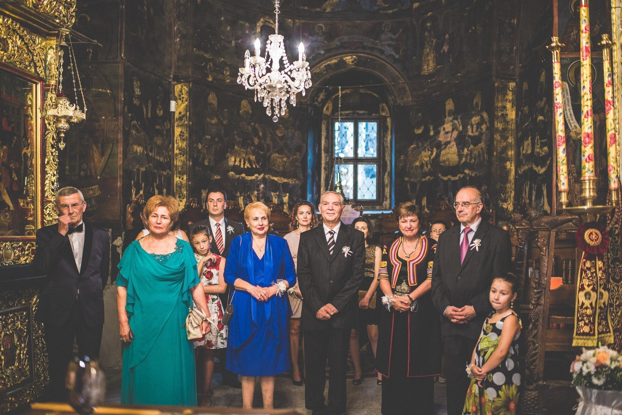 The couple's family gather in the gilded surroundings of the monastery