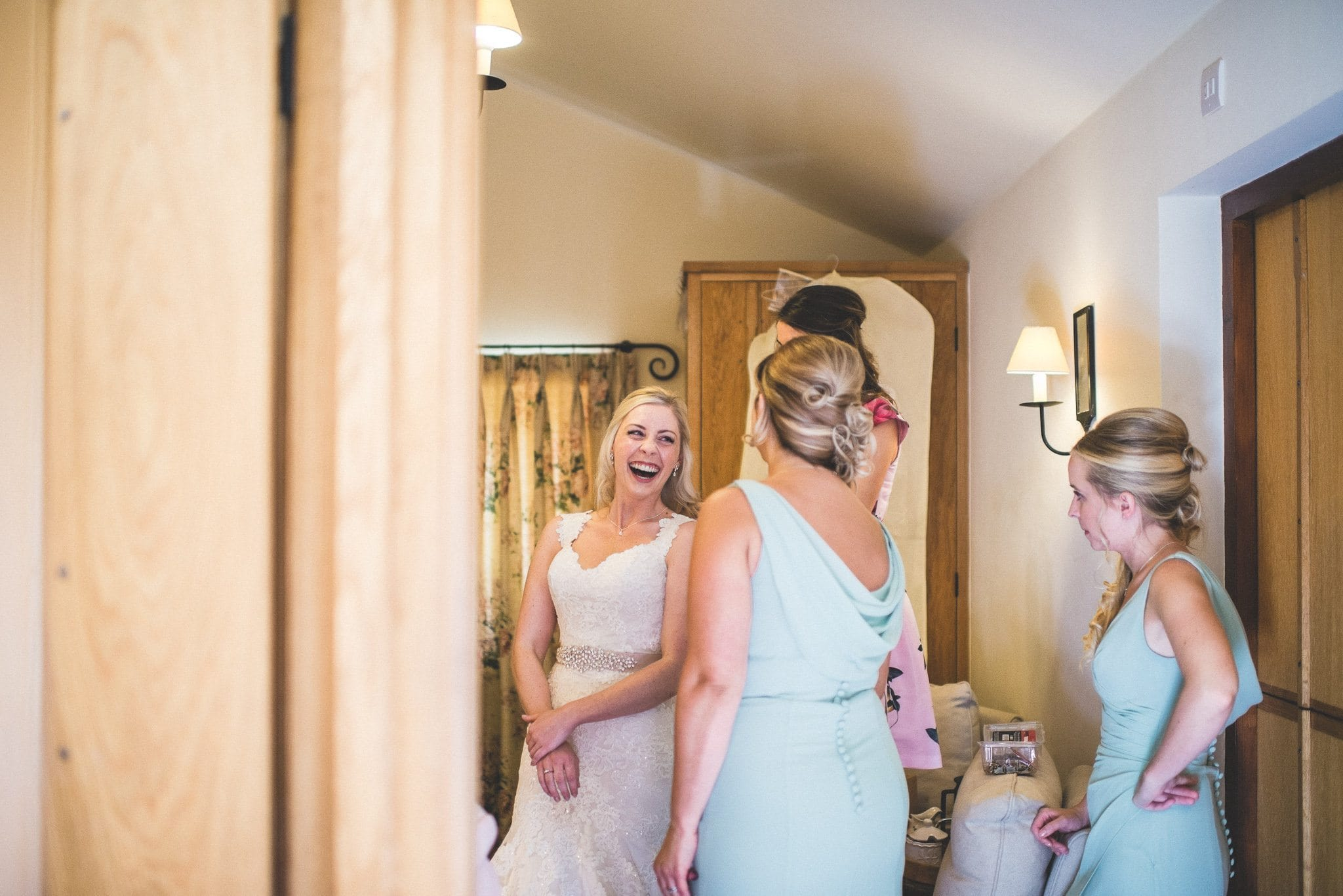 Bride Emma laughs with her bridesmaids
