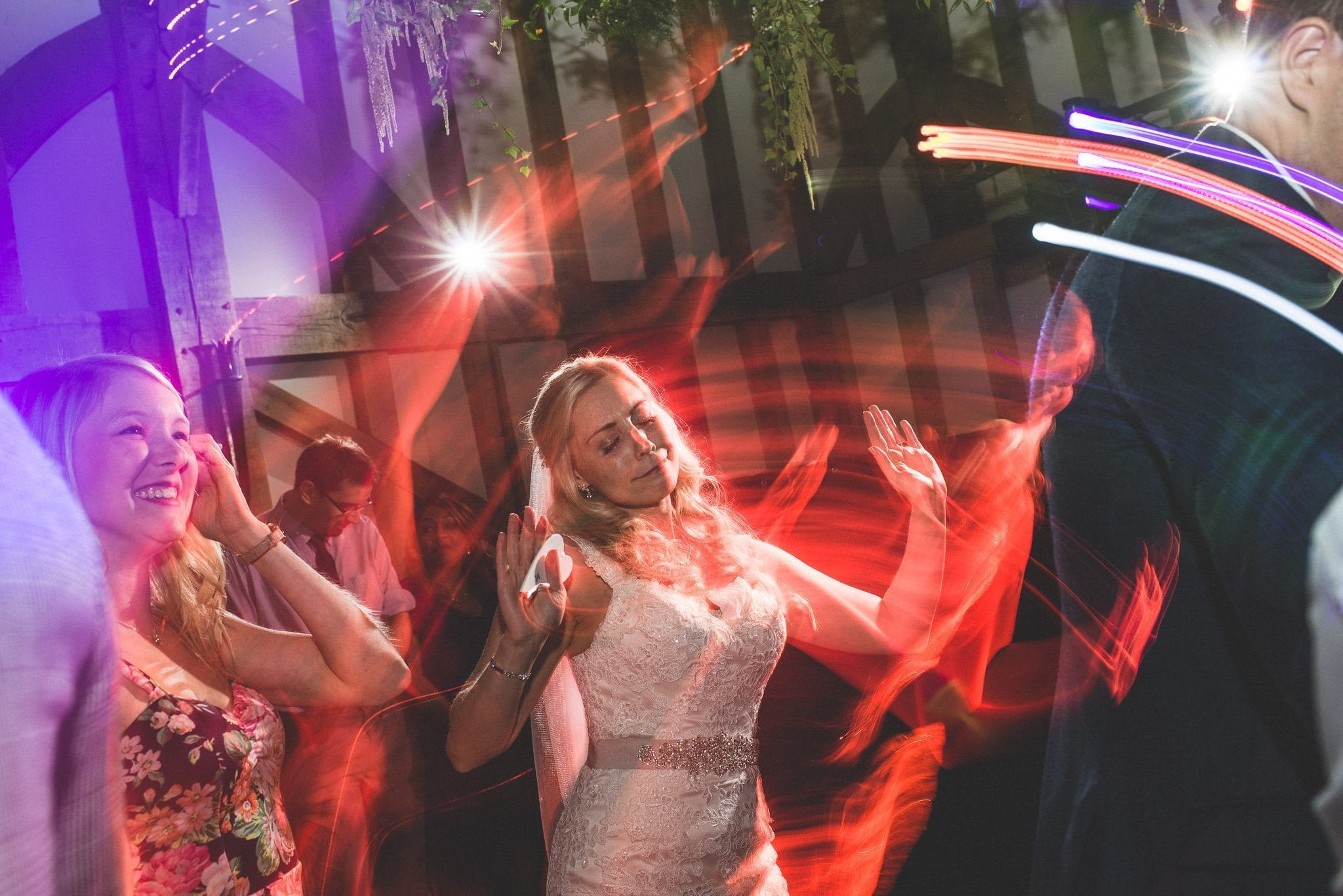 The party is in full swing and Emma shows off her moves as disco lights flash different colours on the dance floor