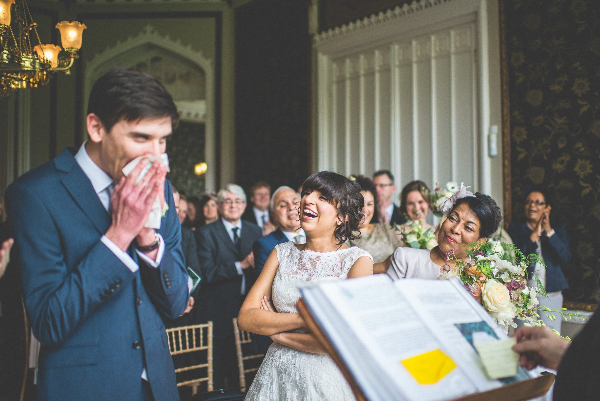 An emotional Andy blows his nose sheepishly, while his new bride bursts out laughing