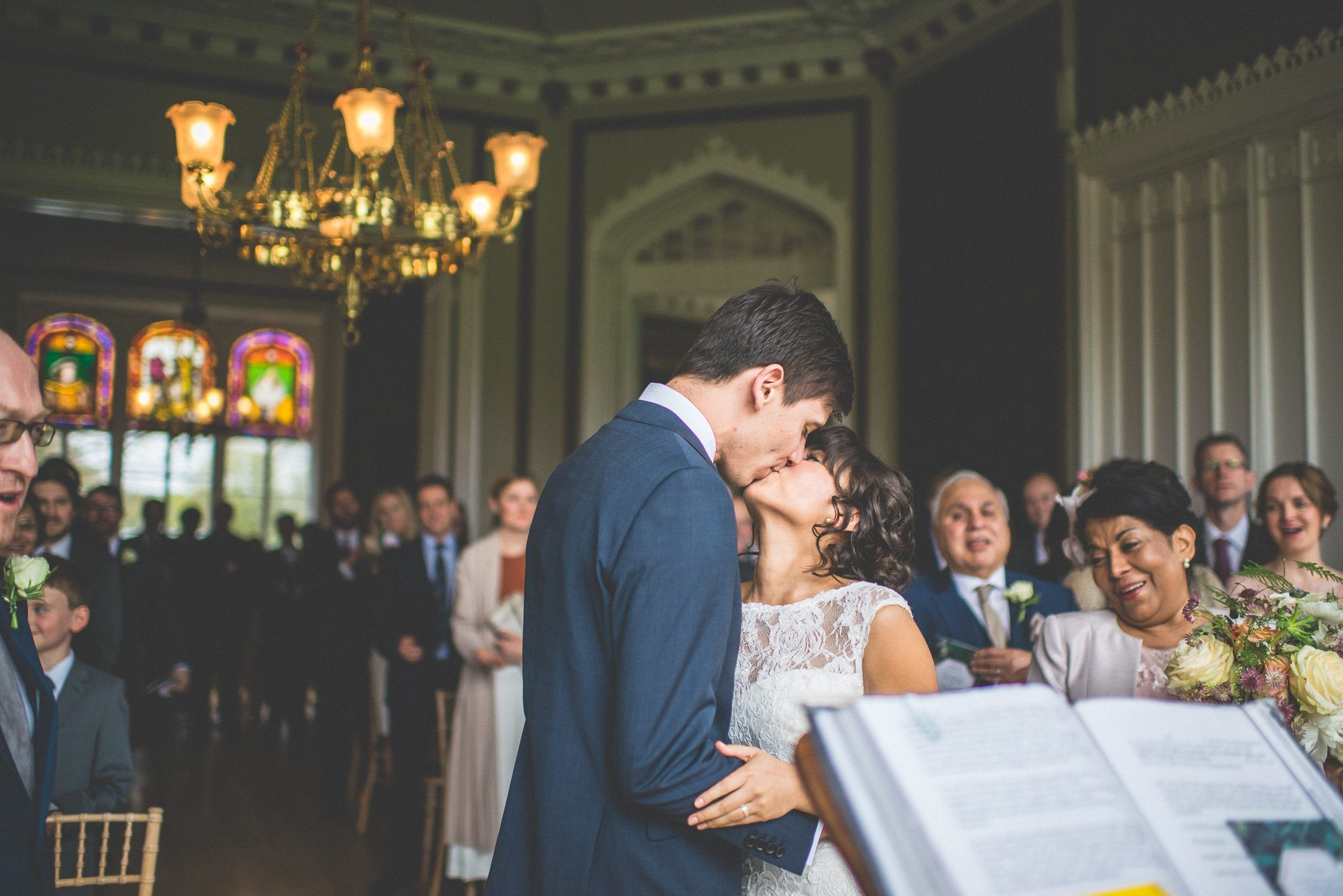 The newlyweds kiss as they are pronounced husband and wife.