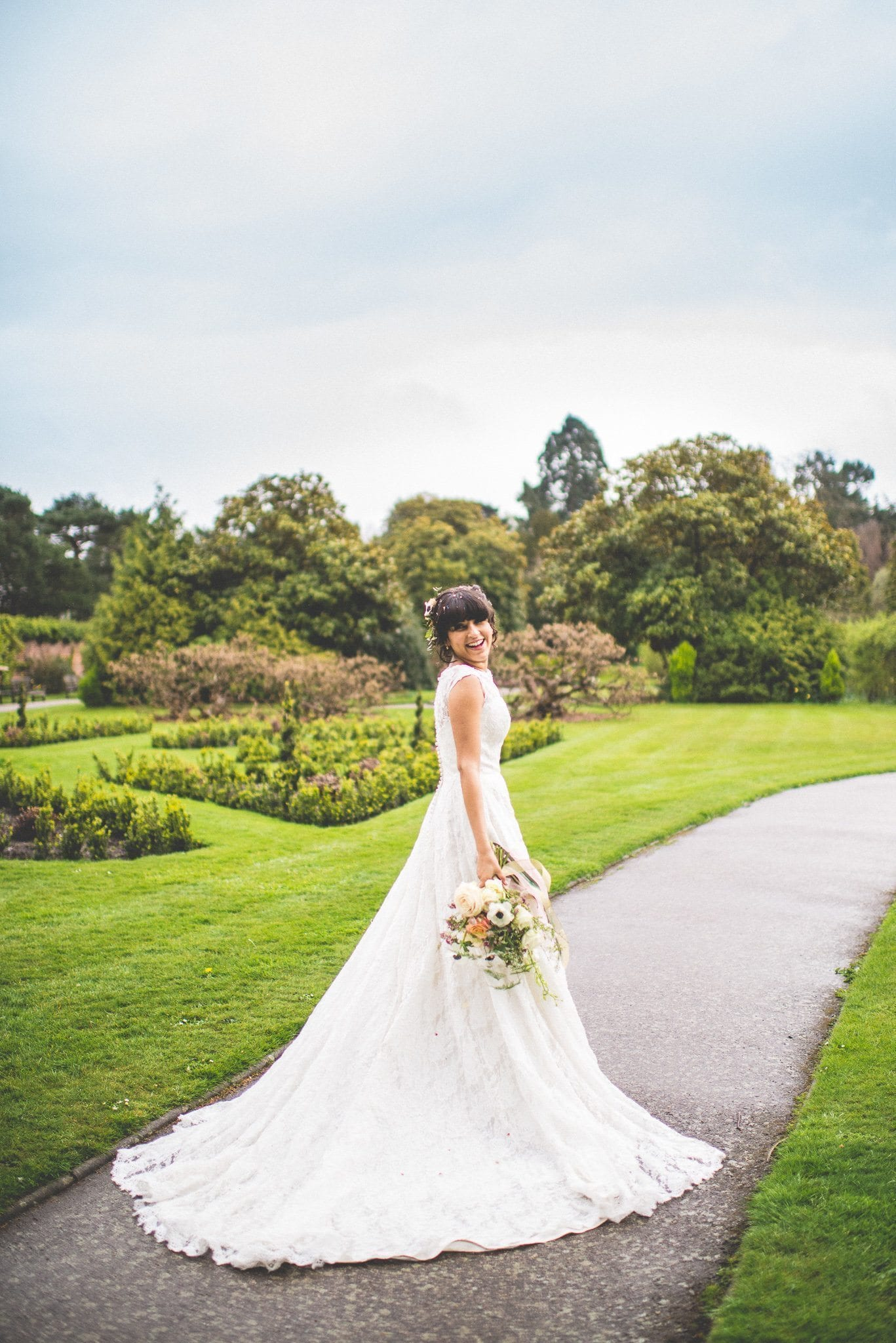 Bride takes a walk in the grounds of Nonsuch Mansion