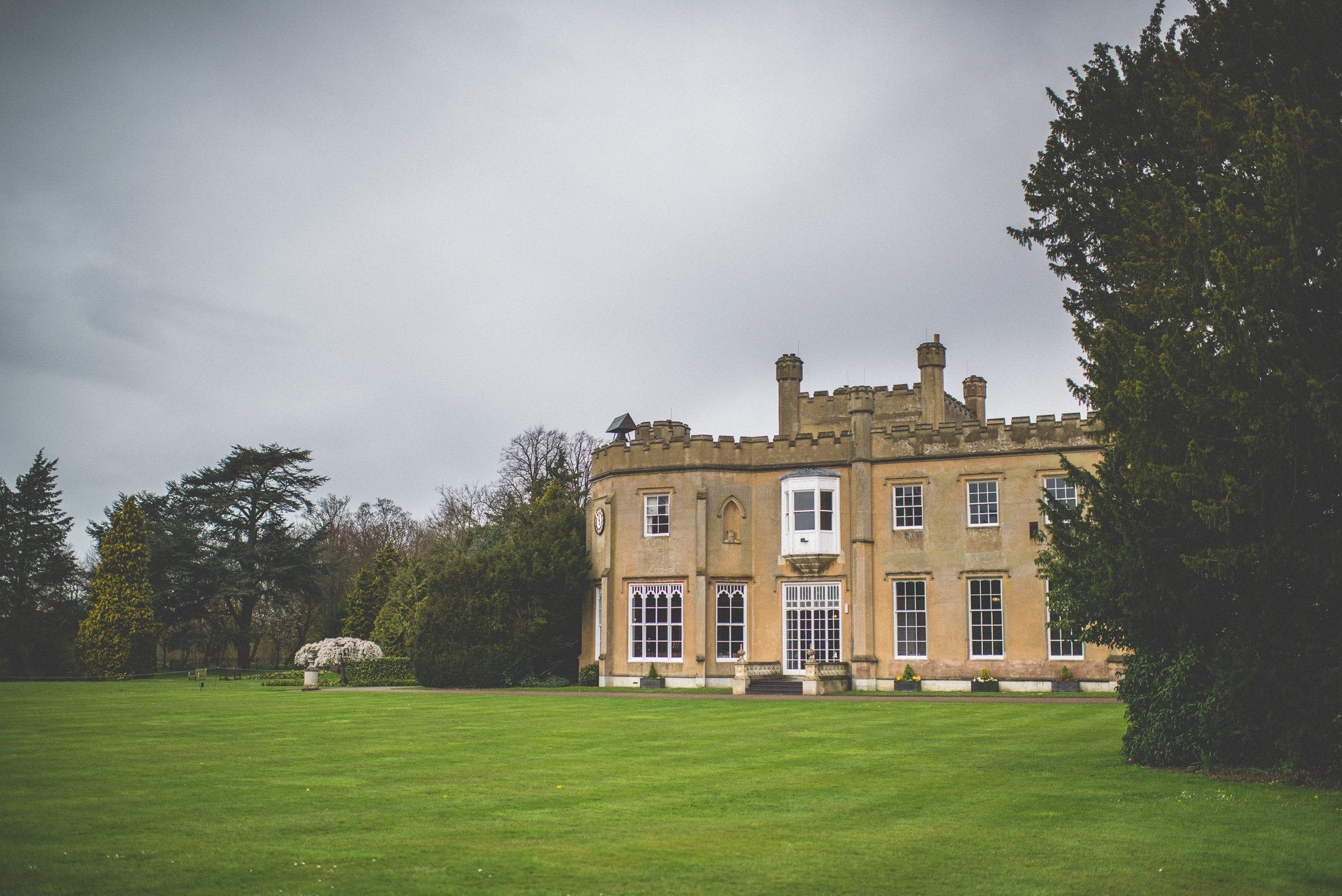 An exterior shot of Nonsuch Mansion with grey clouds gathering