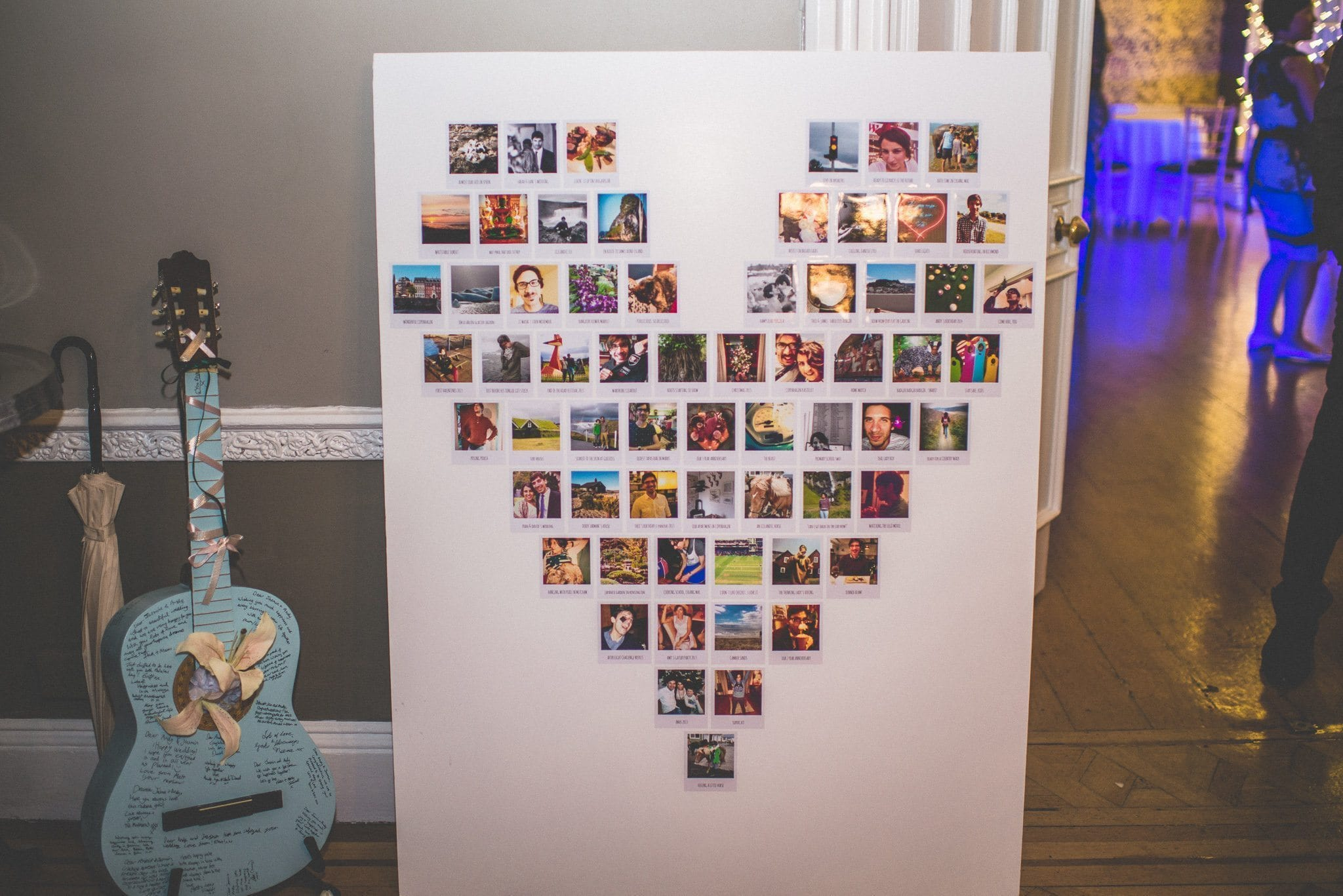 A heart made up of polaroids of the couple is on display next to the blue guitar guest book, now covered in signatures
