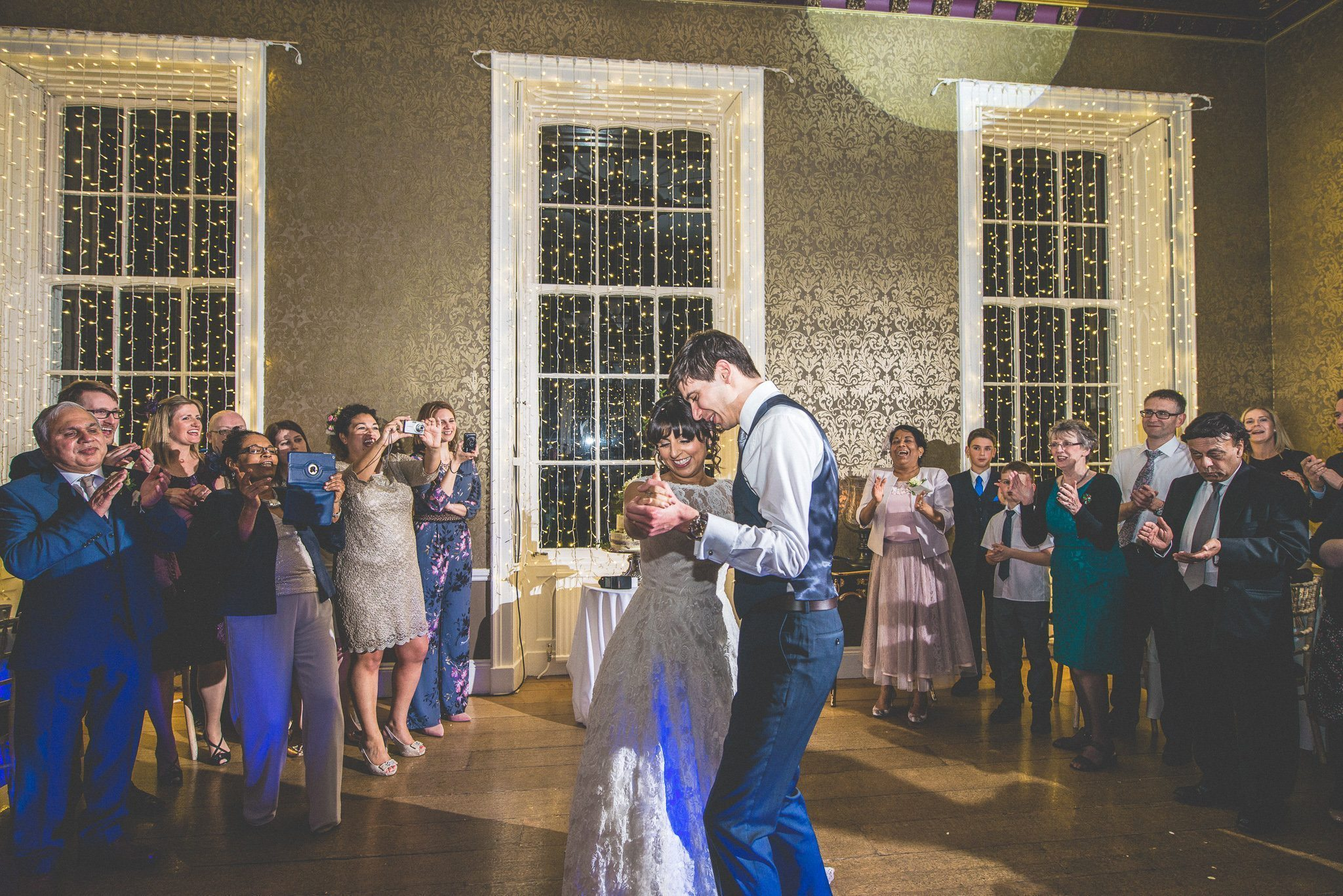The couple show off their moves on the dancefloor as guests look on and take photos