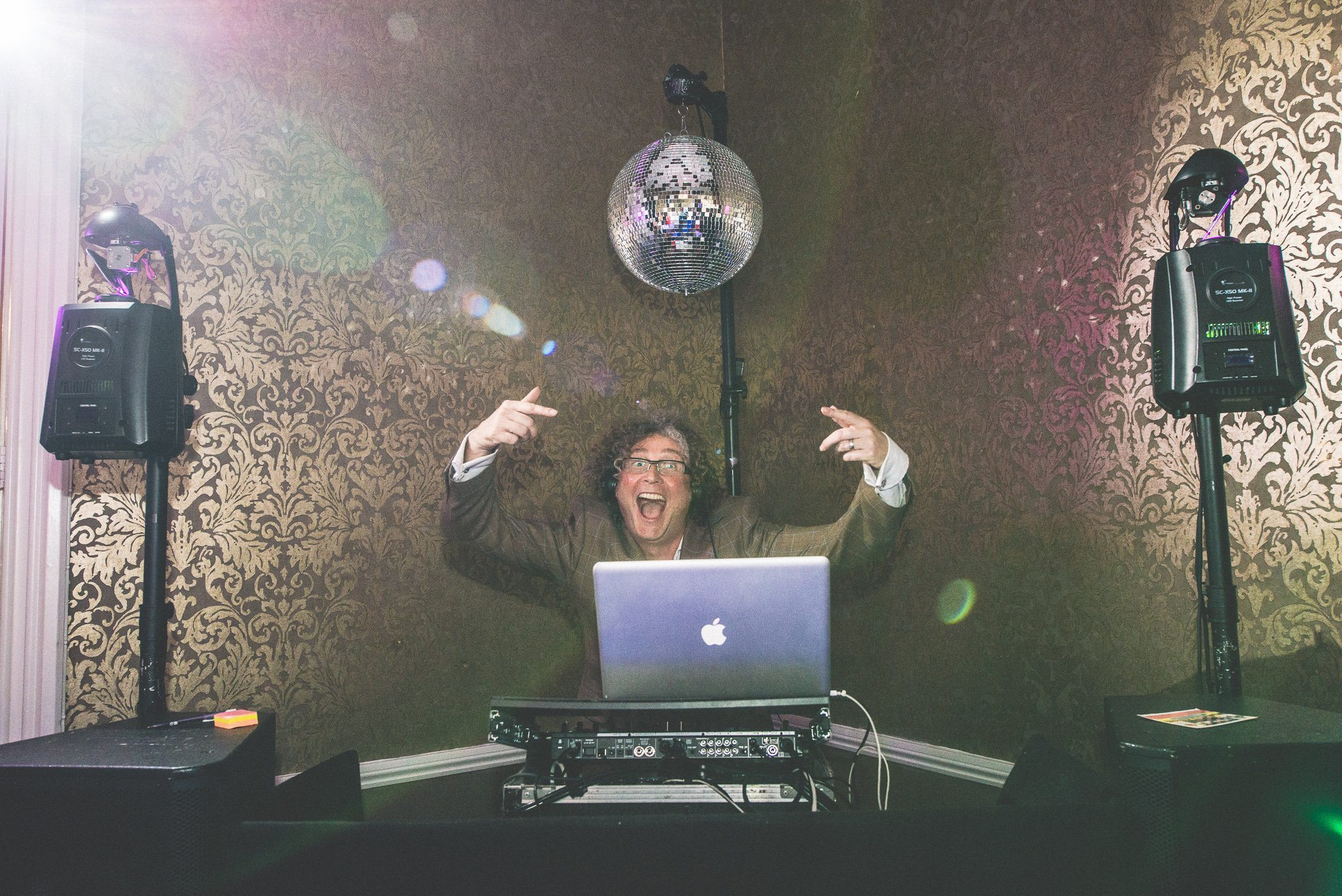 A guest is VERY EXCITED at the prospect of DJing as the party gets going.