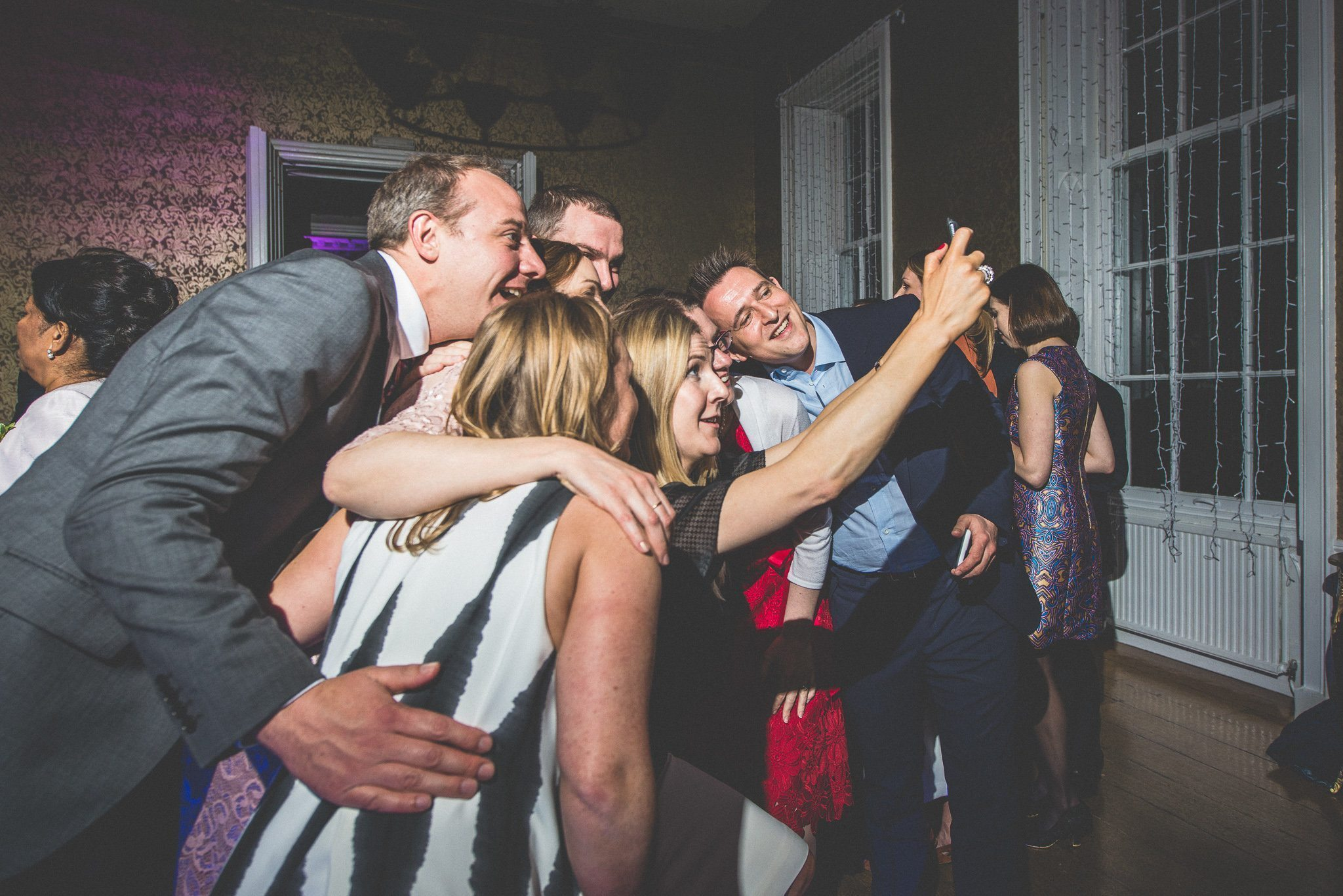 A group of guests pose for a selfie on the dancefloor