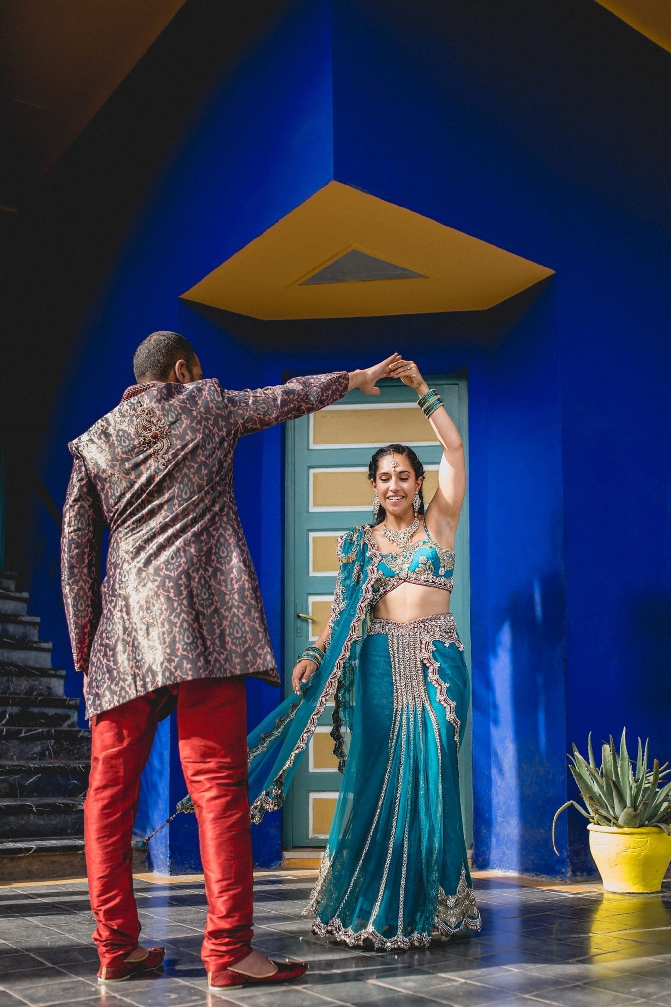 Indian Groom twirls his bride at the Majorelle Gardens in Marrakech