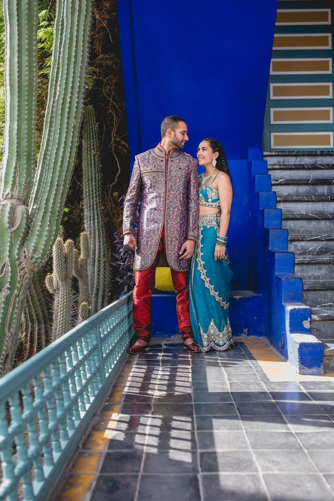 Asian Bride and Groom look at each at the Majorelle Gardens in Marrakech