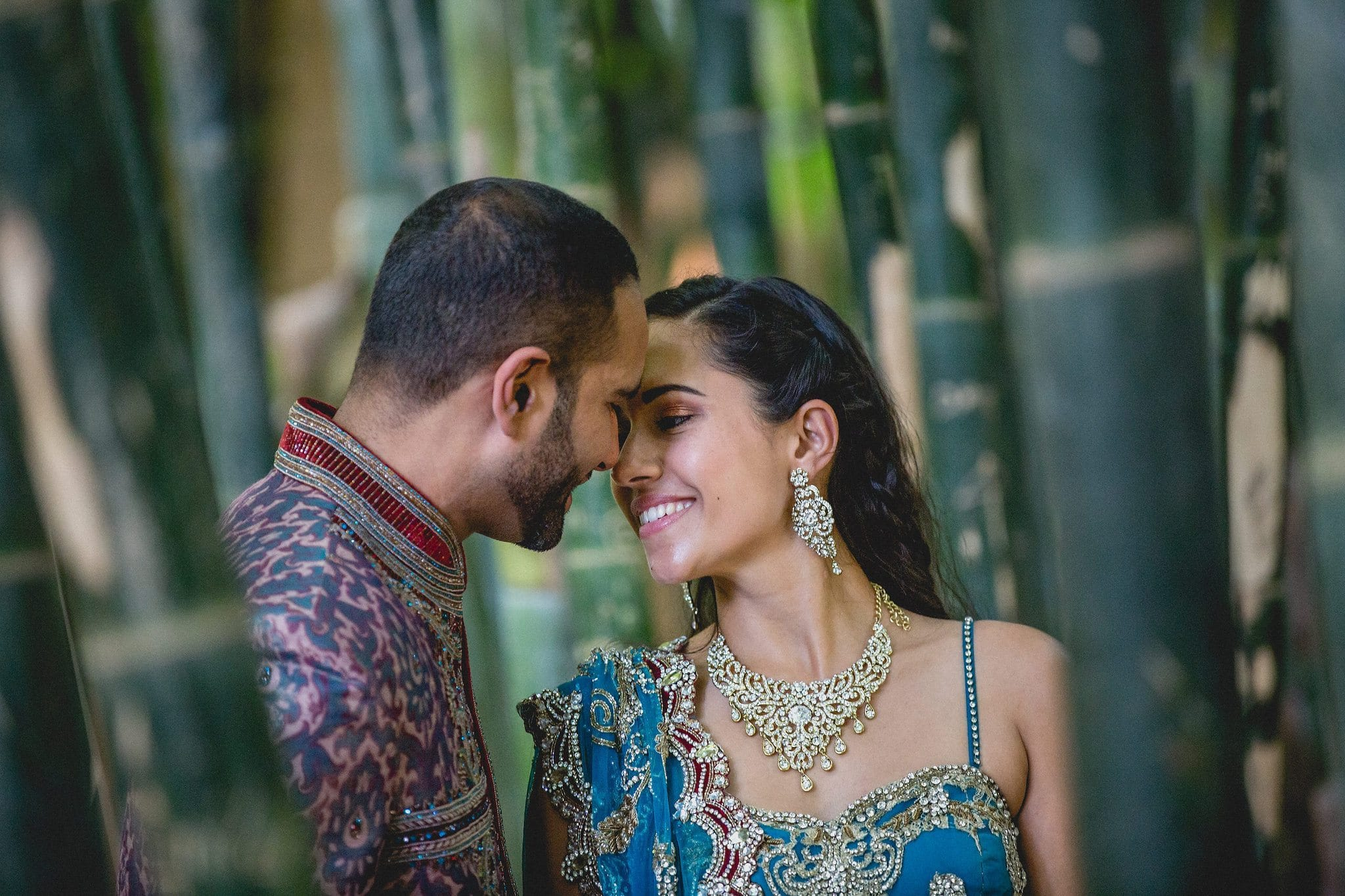 Indian bride and groom lean in for a kiss at their Marrakech destination wedding