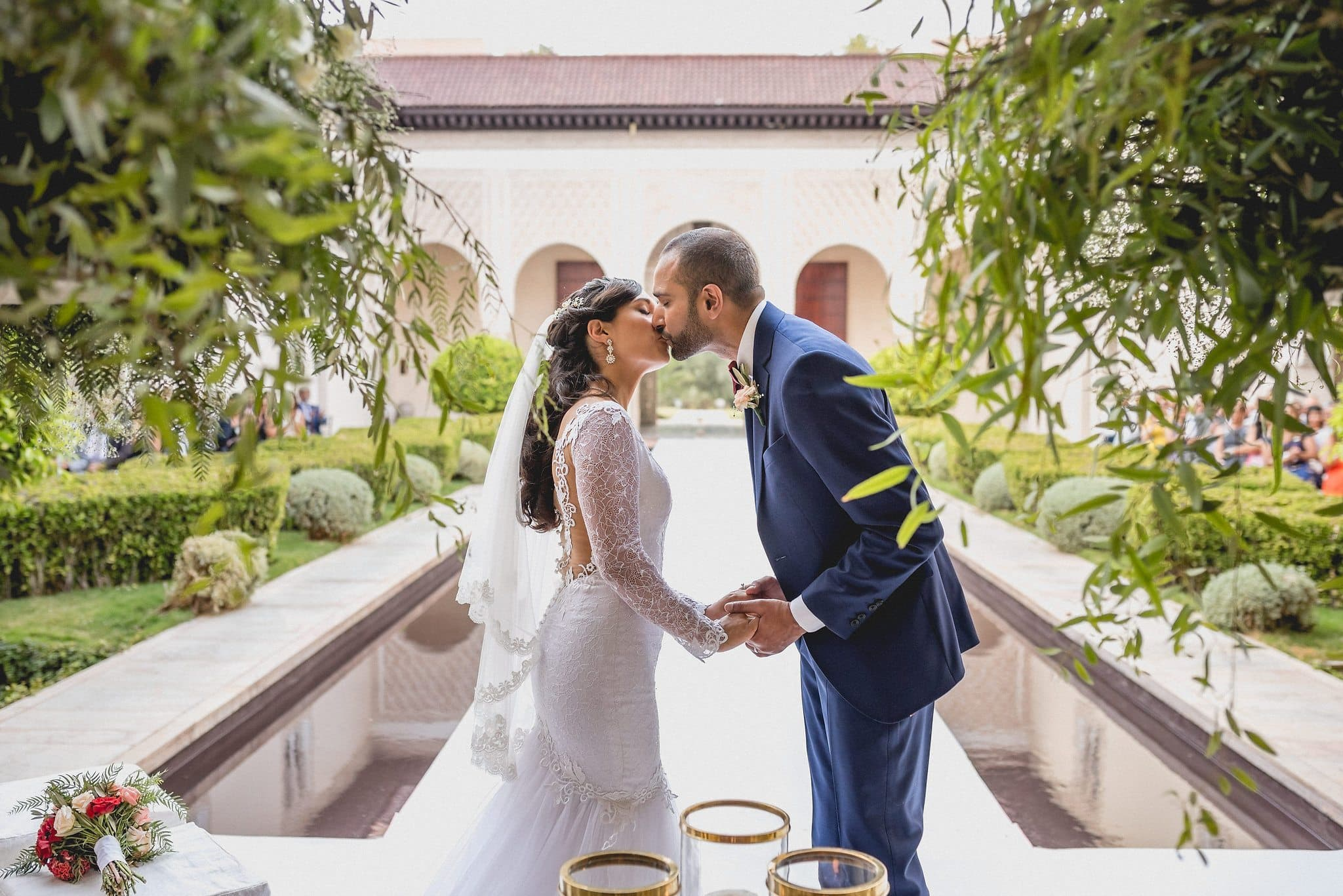 The wedding couple kiss at the end of the aisle