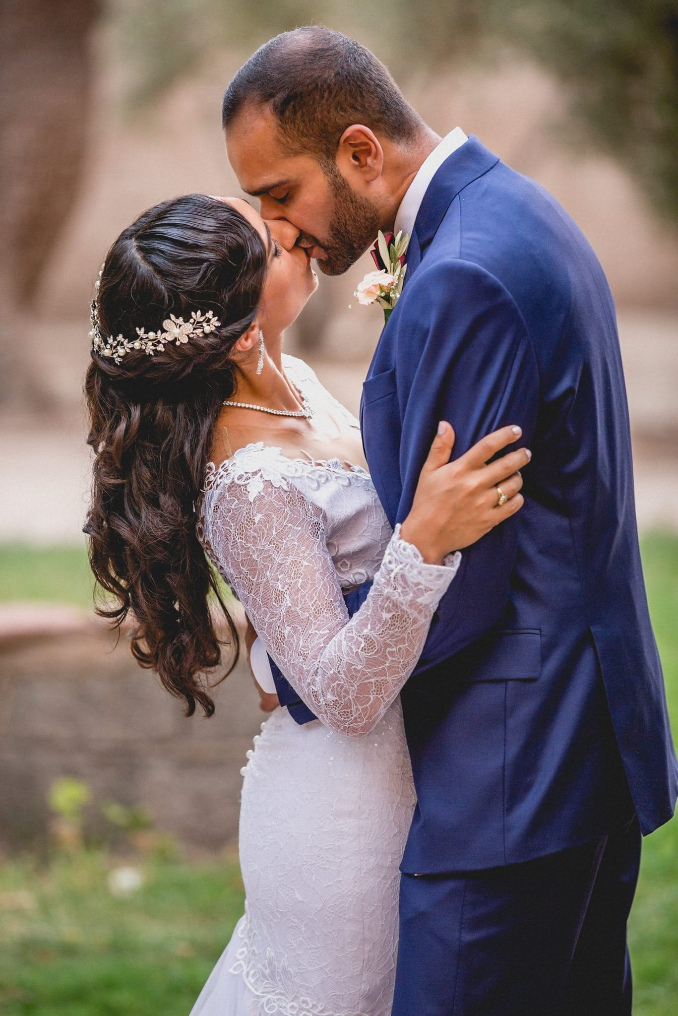 The wedding couple kiss deeply during their portrait session.