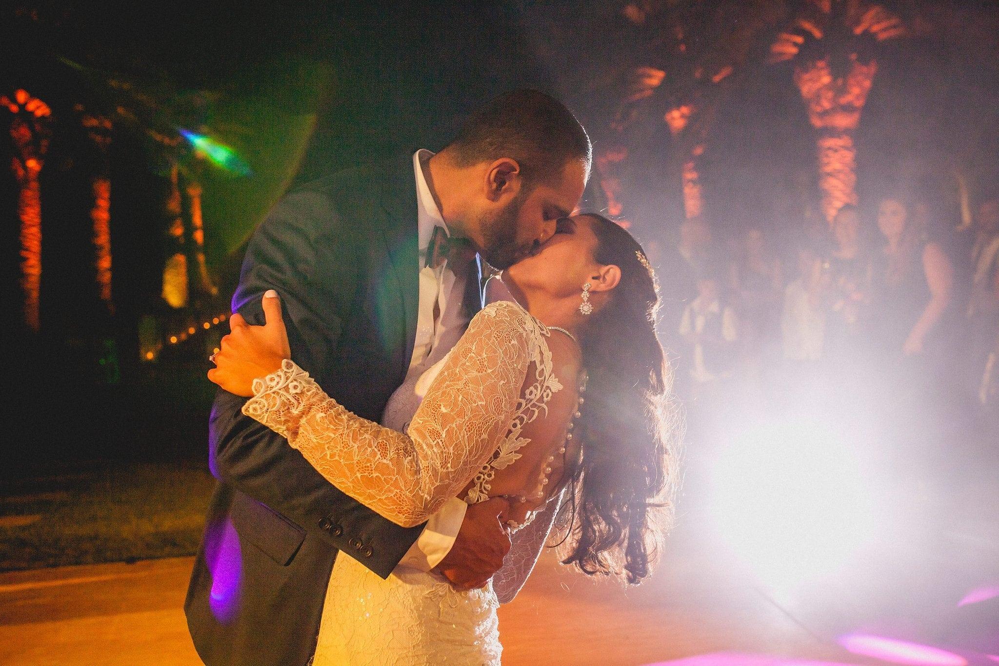 Bride and groom kiss on the dancefloor at Ksar Char Bagh